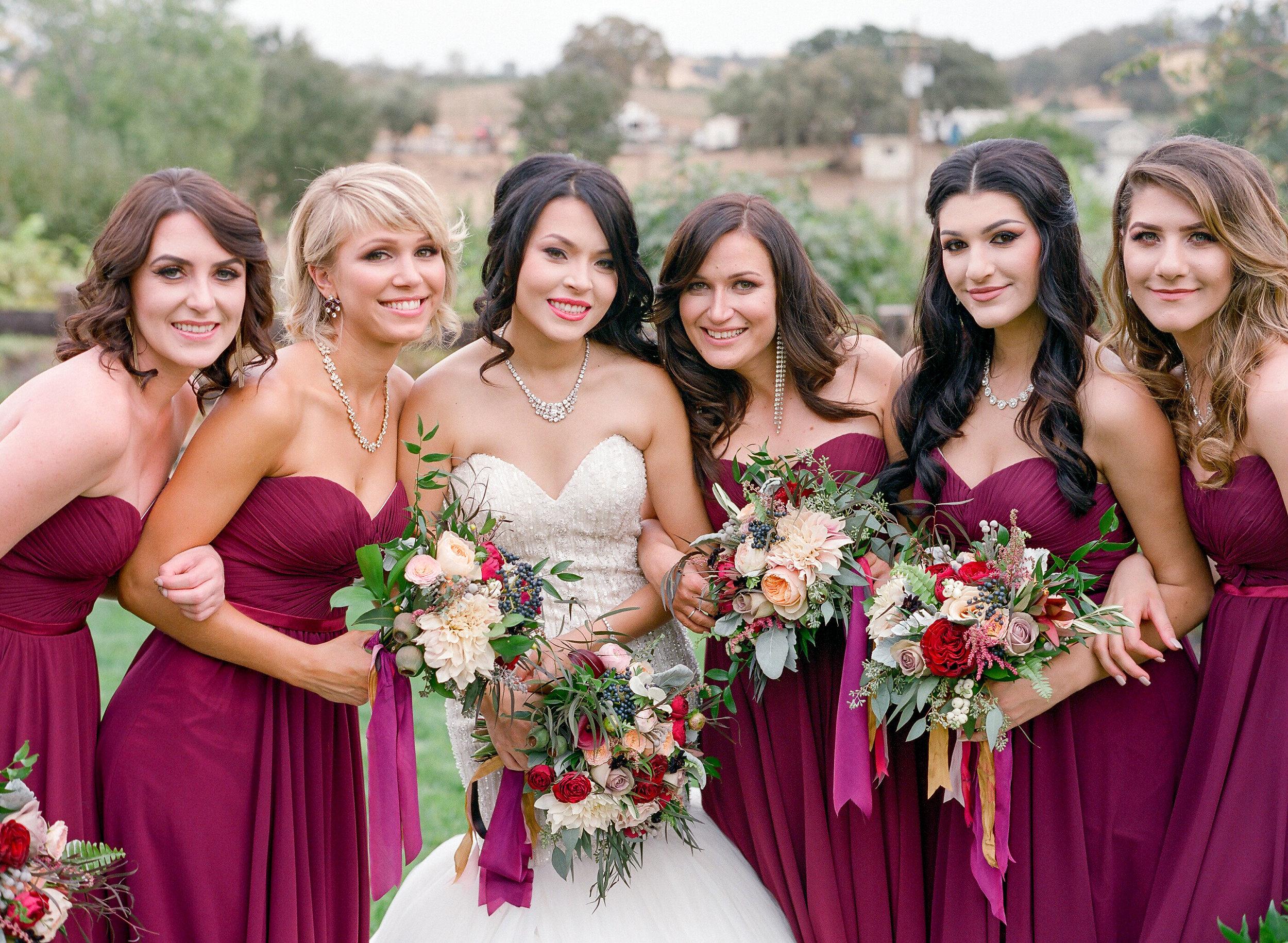 Amador_County_Wedding_Bride_Bridesmaids_Bouquets_Pose_Rancho_Victoria_Vineyard_Northern_California.jpg