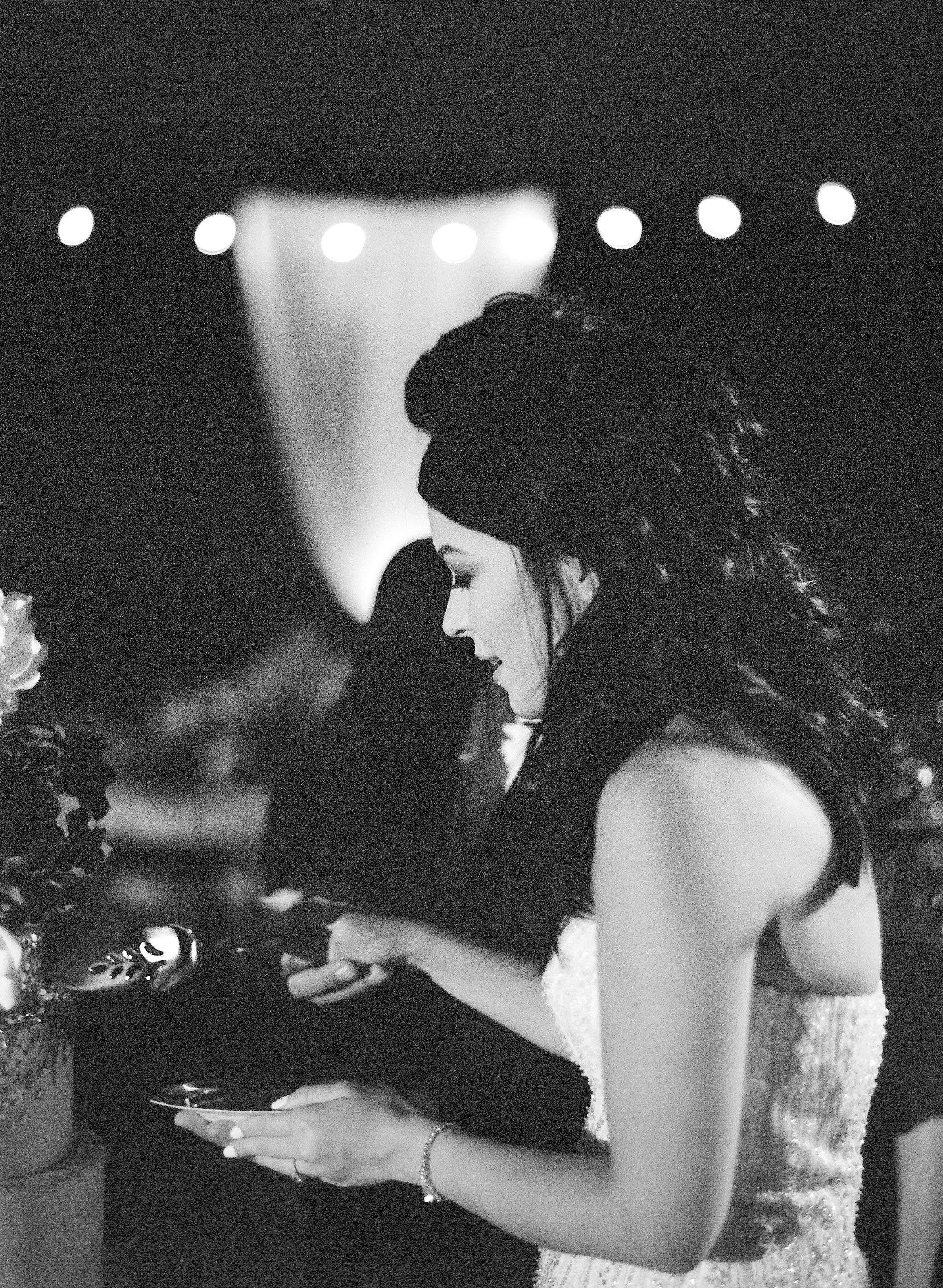 Amador_County_Wedding_Bride_Cake_Cutting_Romantic_Lights_Rancho_Victoria_Vineyard_Northern_California.jpg