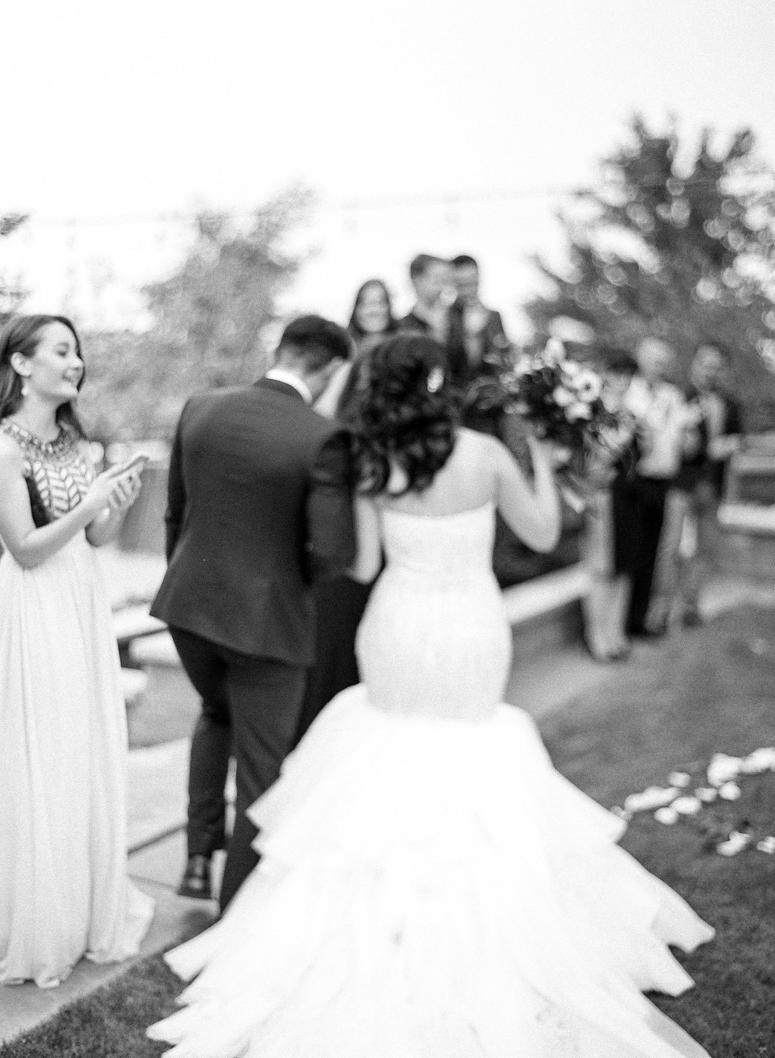 Amador_County_Wedding_Bride_Groom_Aisle_Ceremony_Black_White_Rancho_Victoria_Vineyard_Northern_California.jpg