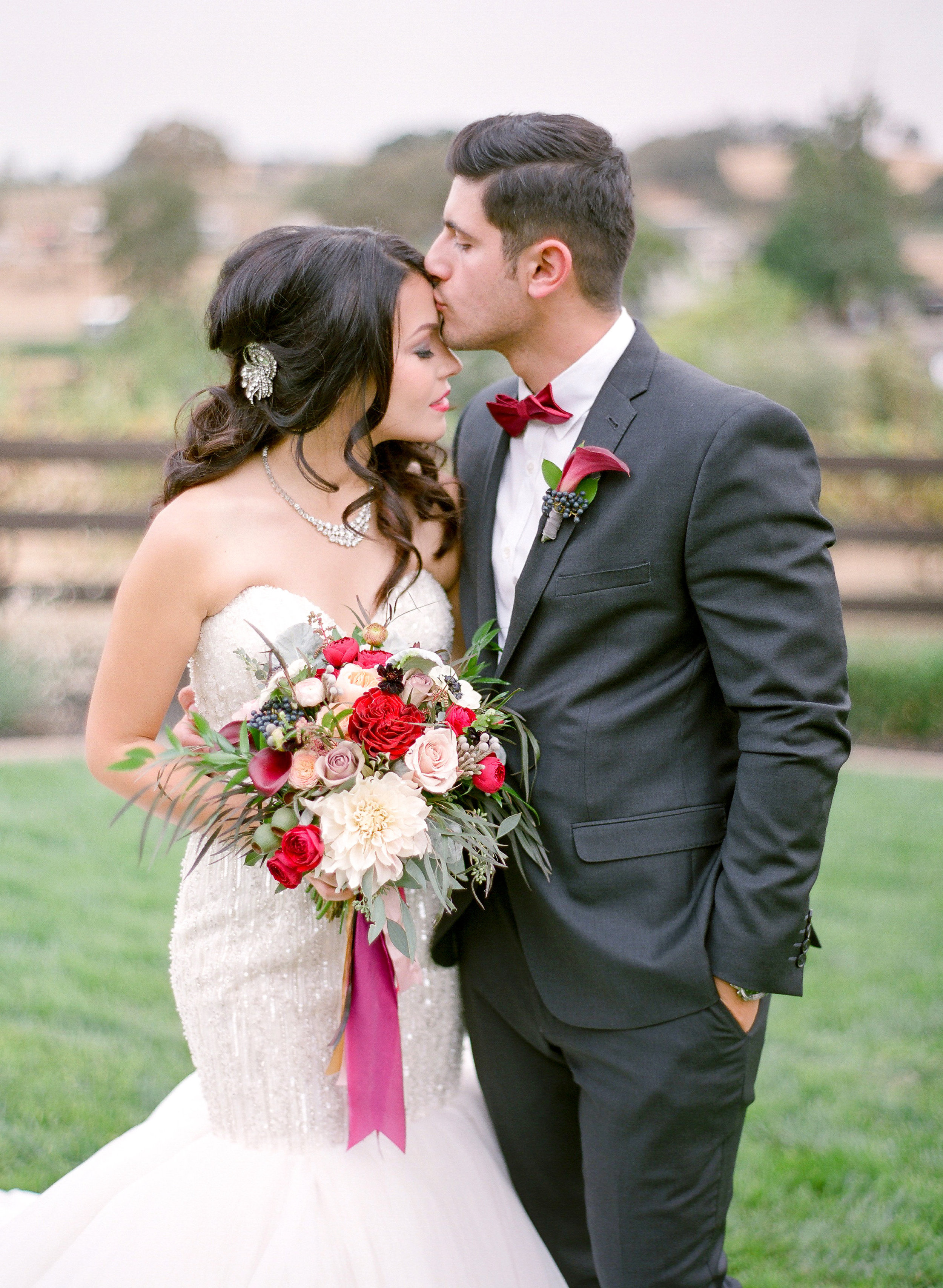 Amador_County_Wedding_Bride_Groom_Forhead_Kiss_Bouquet_Boutonniere_Rancho_Victoria_Vineyard_Northern_California.jpg