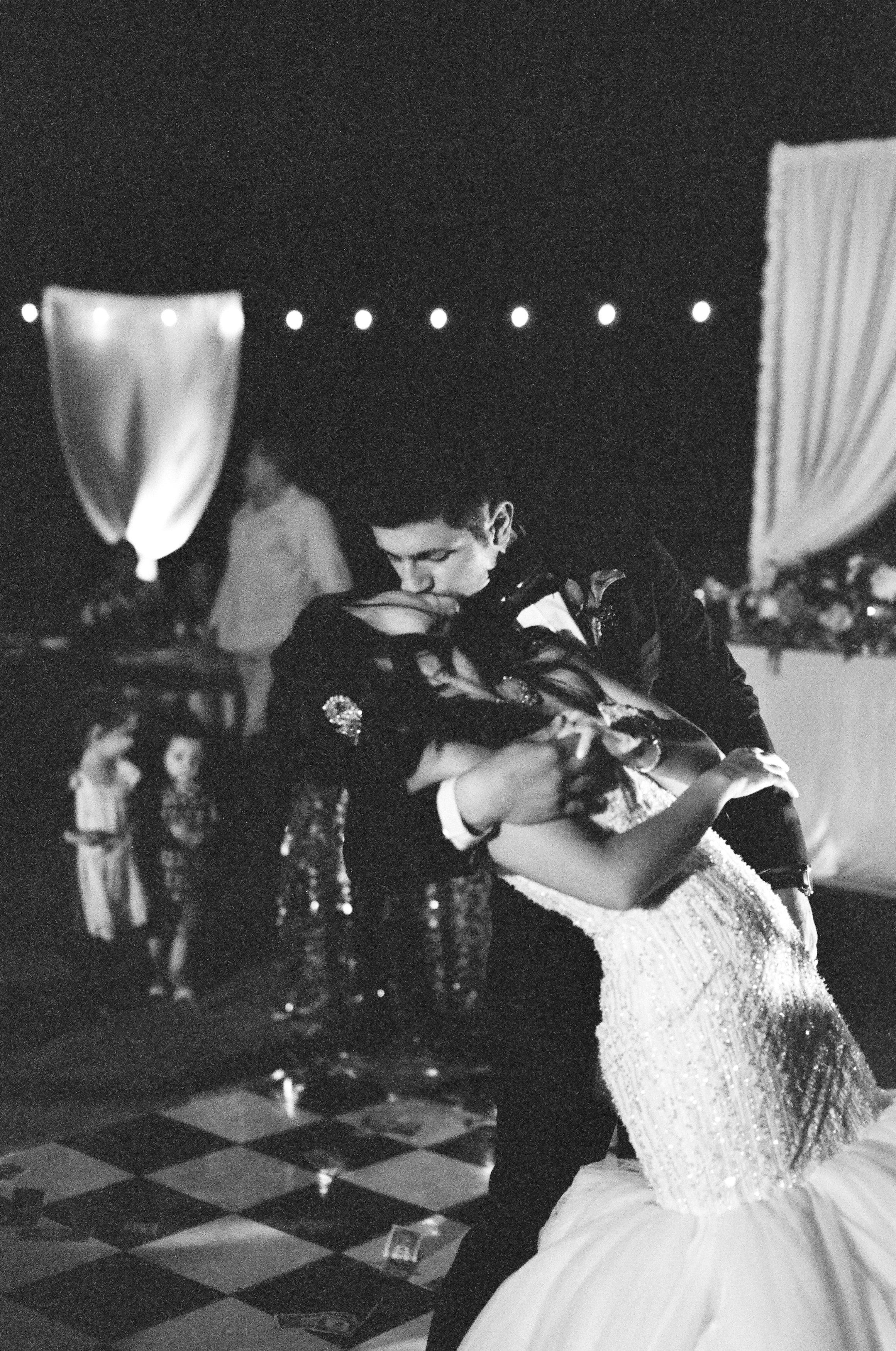 Amador_County_Wedding_Bride_Groom_Kiss_Dance_Lights_Black_White_Rancho_Victoria_Vineyard_Northern_California.jpg
