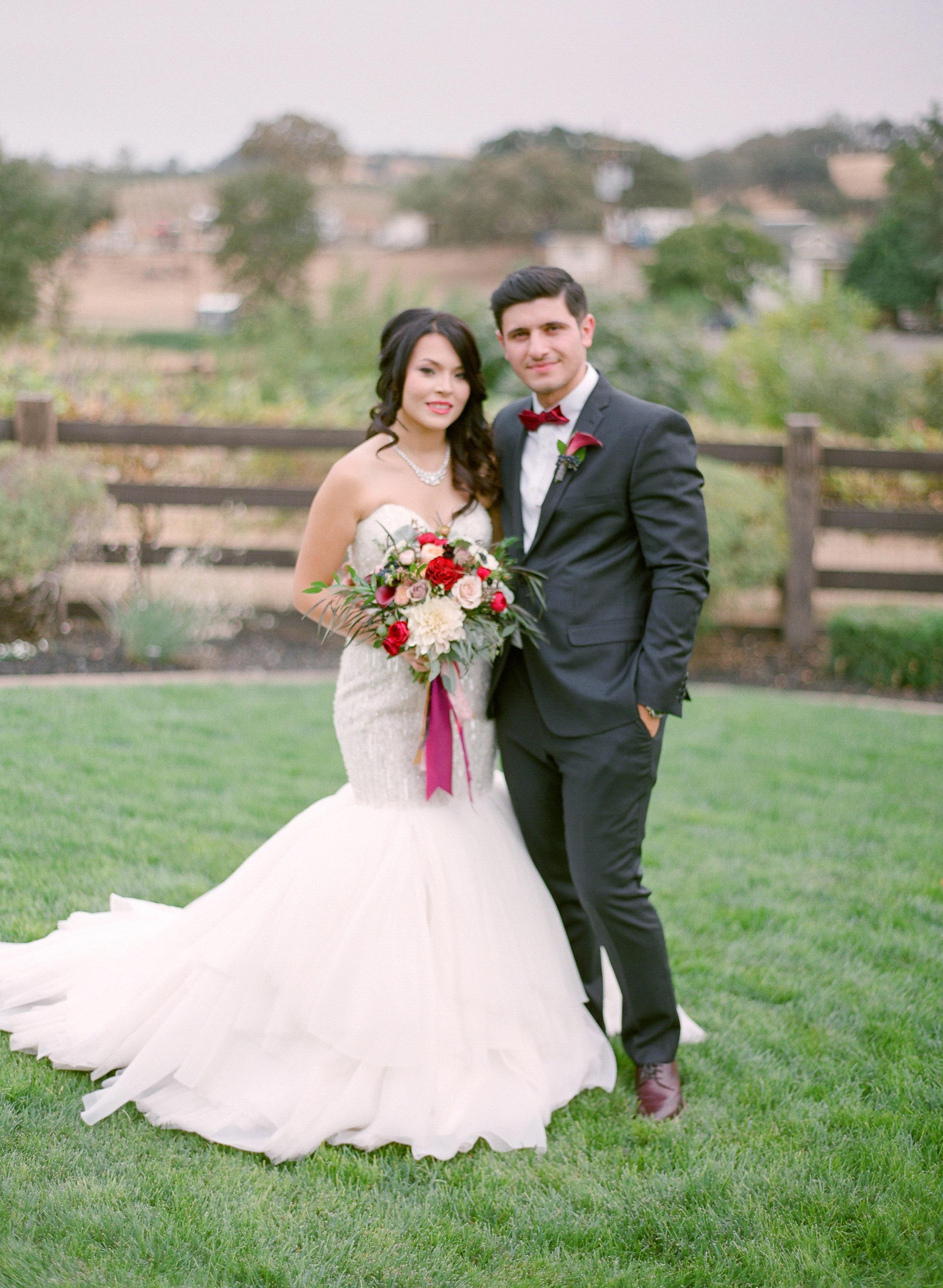 Amador_County_Wedding_Bride_Groom_Pose_Bridal_Bouquet_Rancho_Victoria_Vineyard_Northern_California.jpg