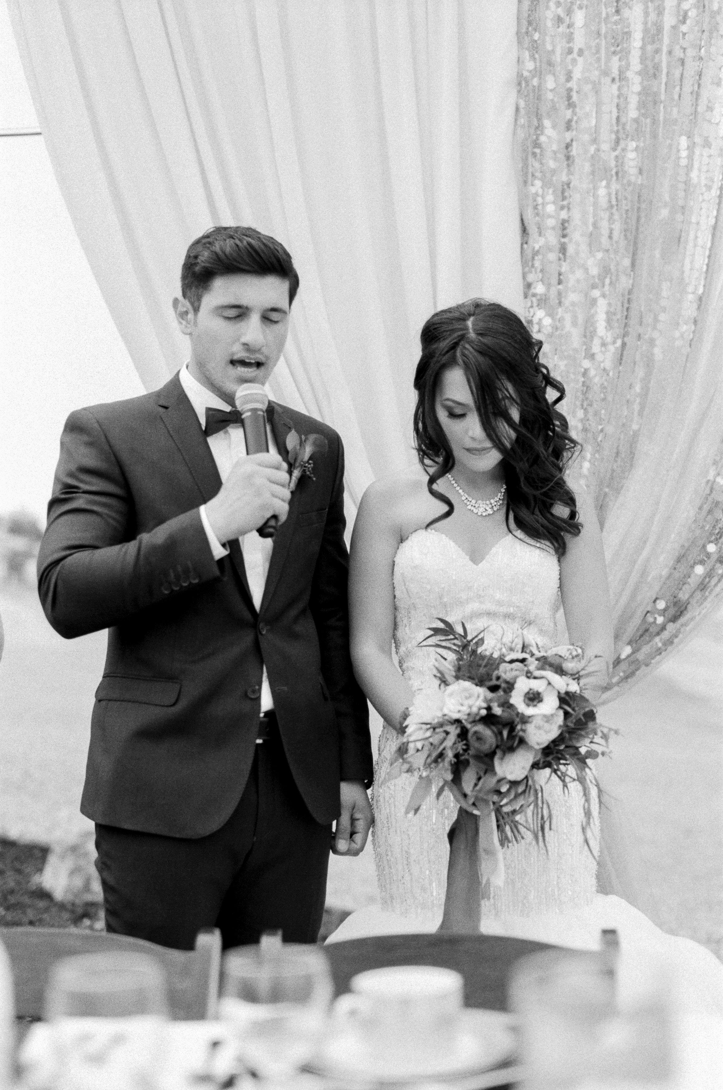 Amador_County_Wedding_Bride_Groom_Praying_Reception_Rancho_Victoria_Vineyard_Northern_California.jpg