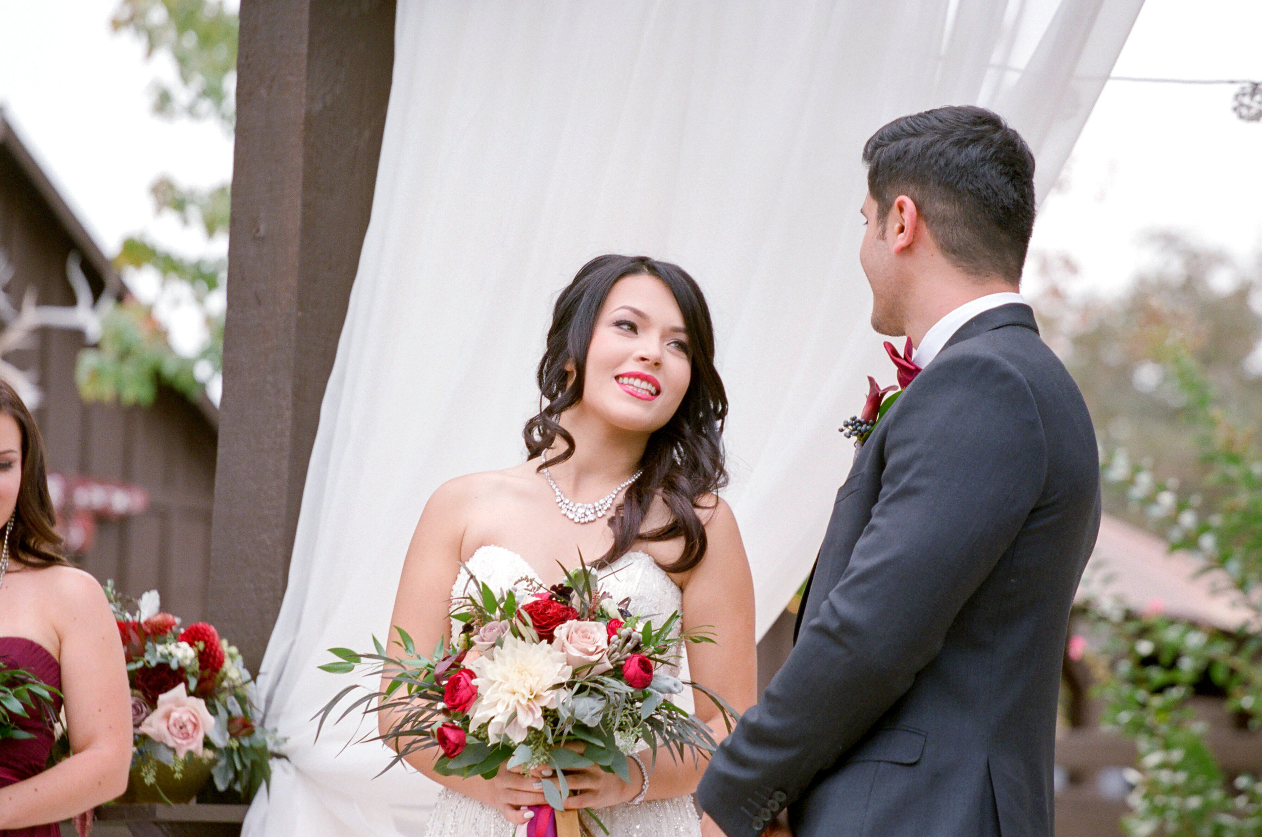 Amador_County_Wedding_Bride_Groom_Vows_Bouquet_Draping_Rancho_Victoria_Vineyard_Northern_California.jpg