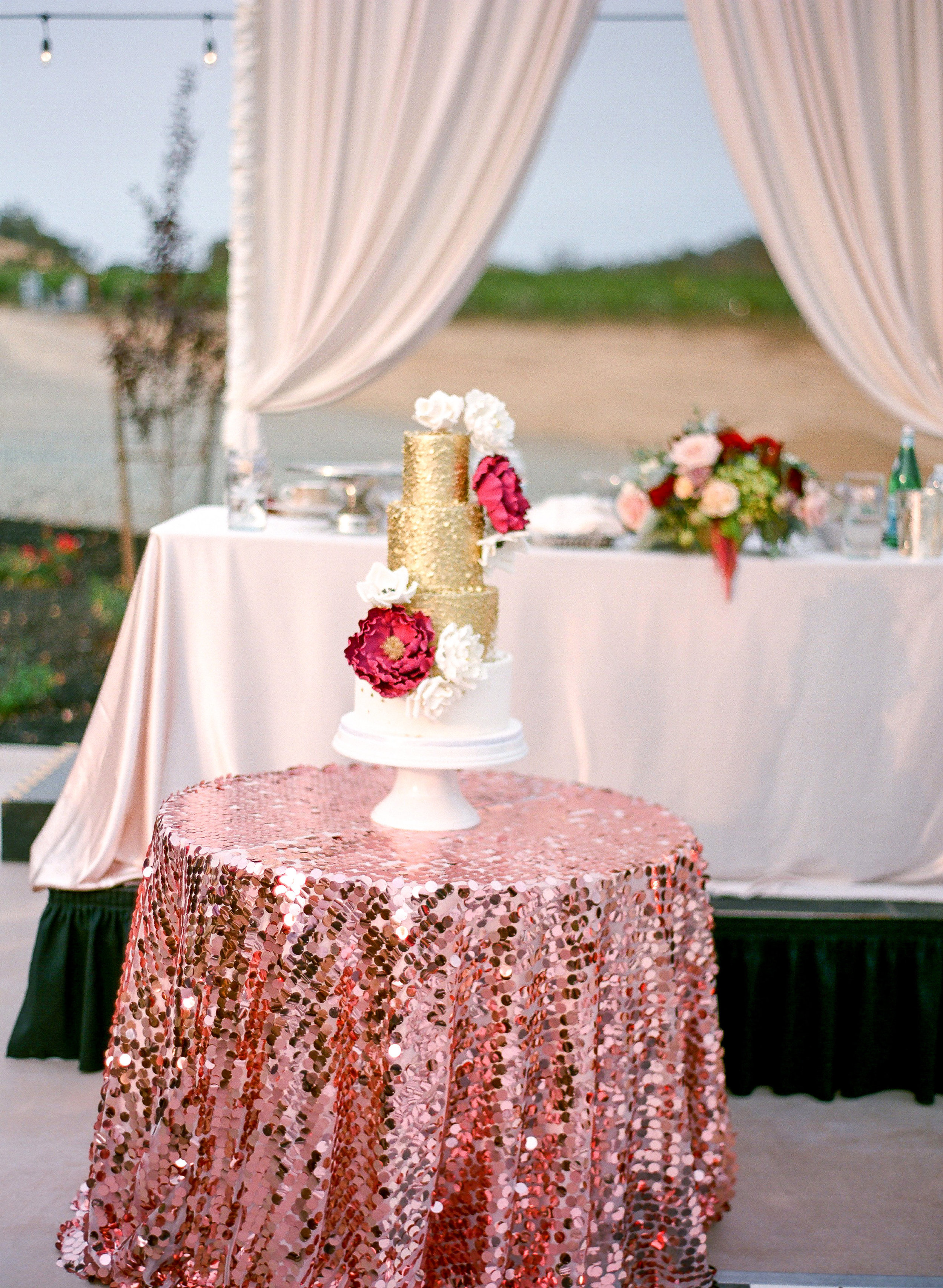 Amador_County_Wedding_Cake_Table_Sequin_Drapping_Rancho_Victoria_Vineyard_Northern_California.jpg