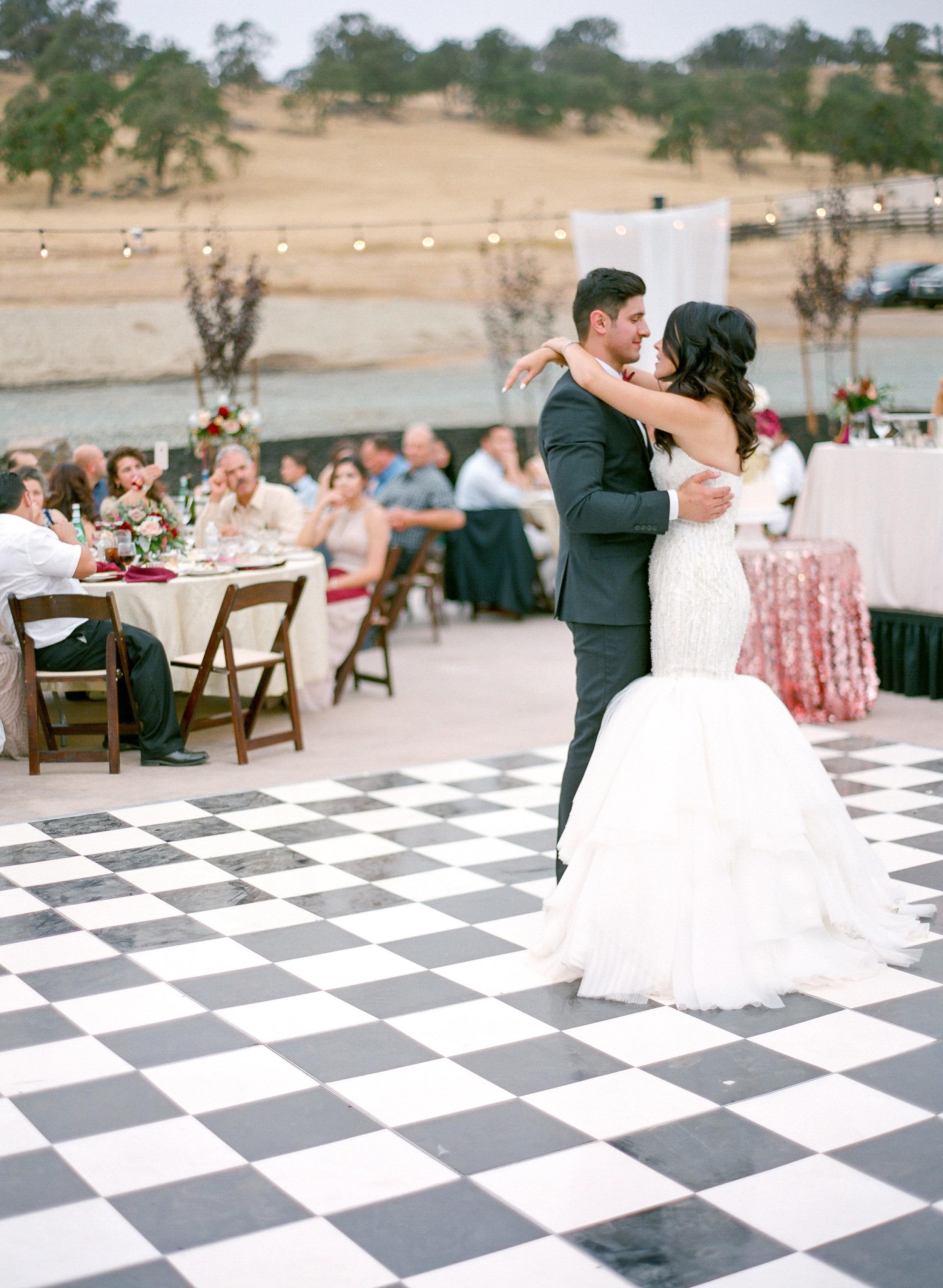 Amador_County_Wedding_Florist_Bride_Groom_Dance_Romantic_Lights_Outdoor_Summer_Evening_Pink_Burgundy_Rancho_Victoria_Vineyard_Northern_California.jpg