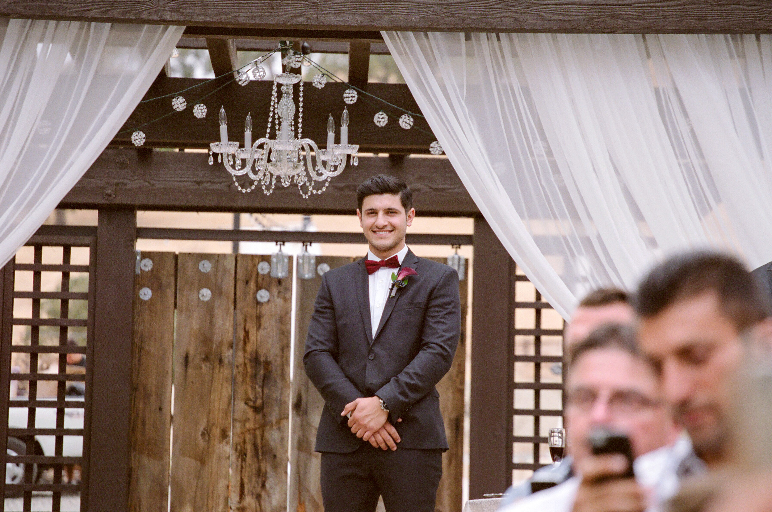 Amador_County_Wedding_Groom_Draping_Crystal_Chandelier_Ceremony_Outdoor_Summer_Evening_Northern_California.jpg