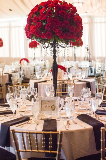 Red_Roses_Carnations_Tall_Black_Candelabra_Centerpiece_Citizen_Hotel_Sacramento_Violette_Fleurs.jpeg