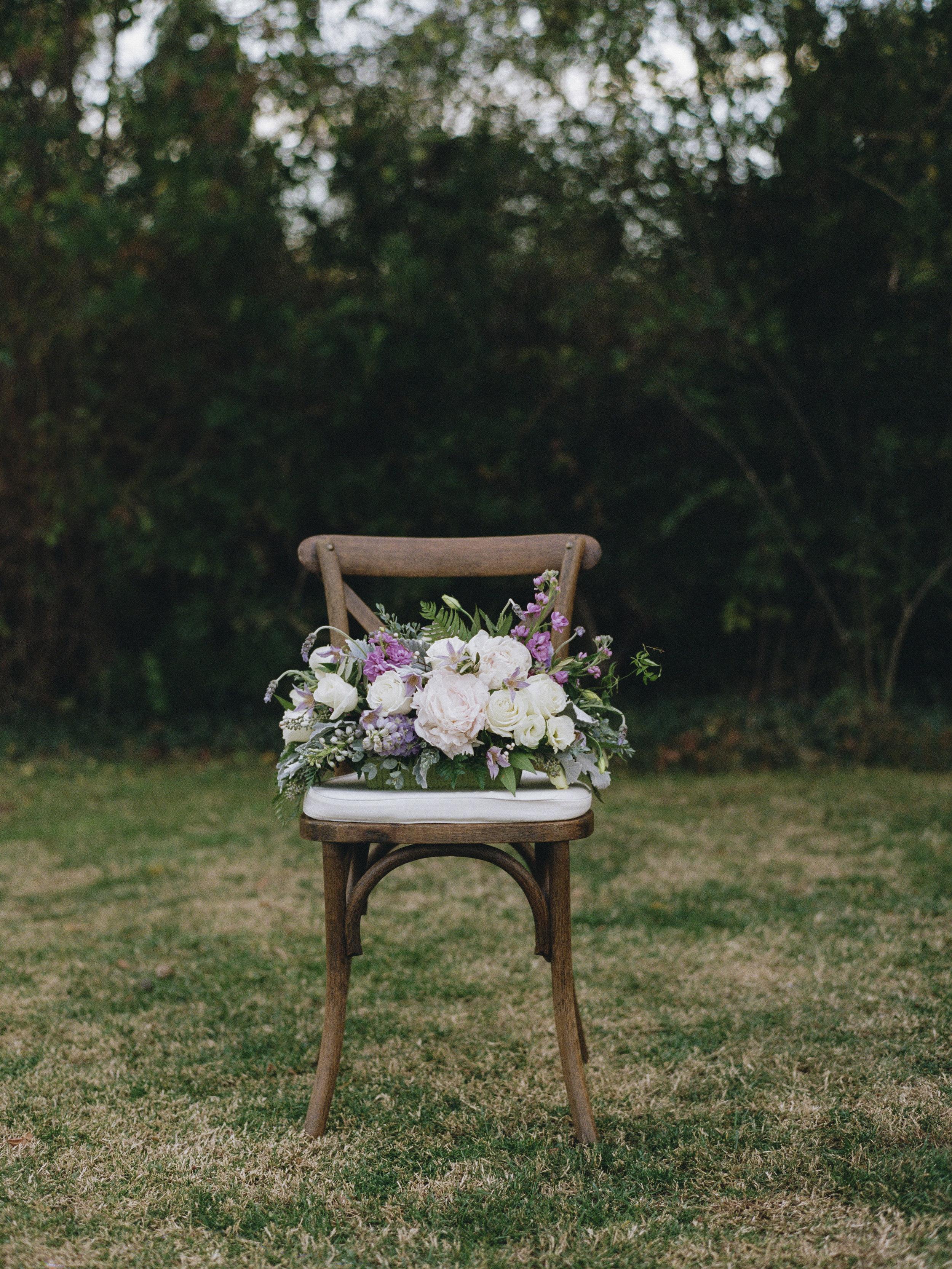 Violette-fleurs-roseville-sacramento-california-Flower-farm-inn-wedding-florist-spring-tablescape-blush-purples-sophisticated-design-chair-nature-upscale.jpg