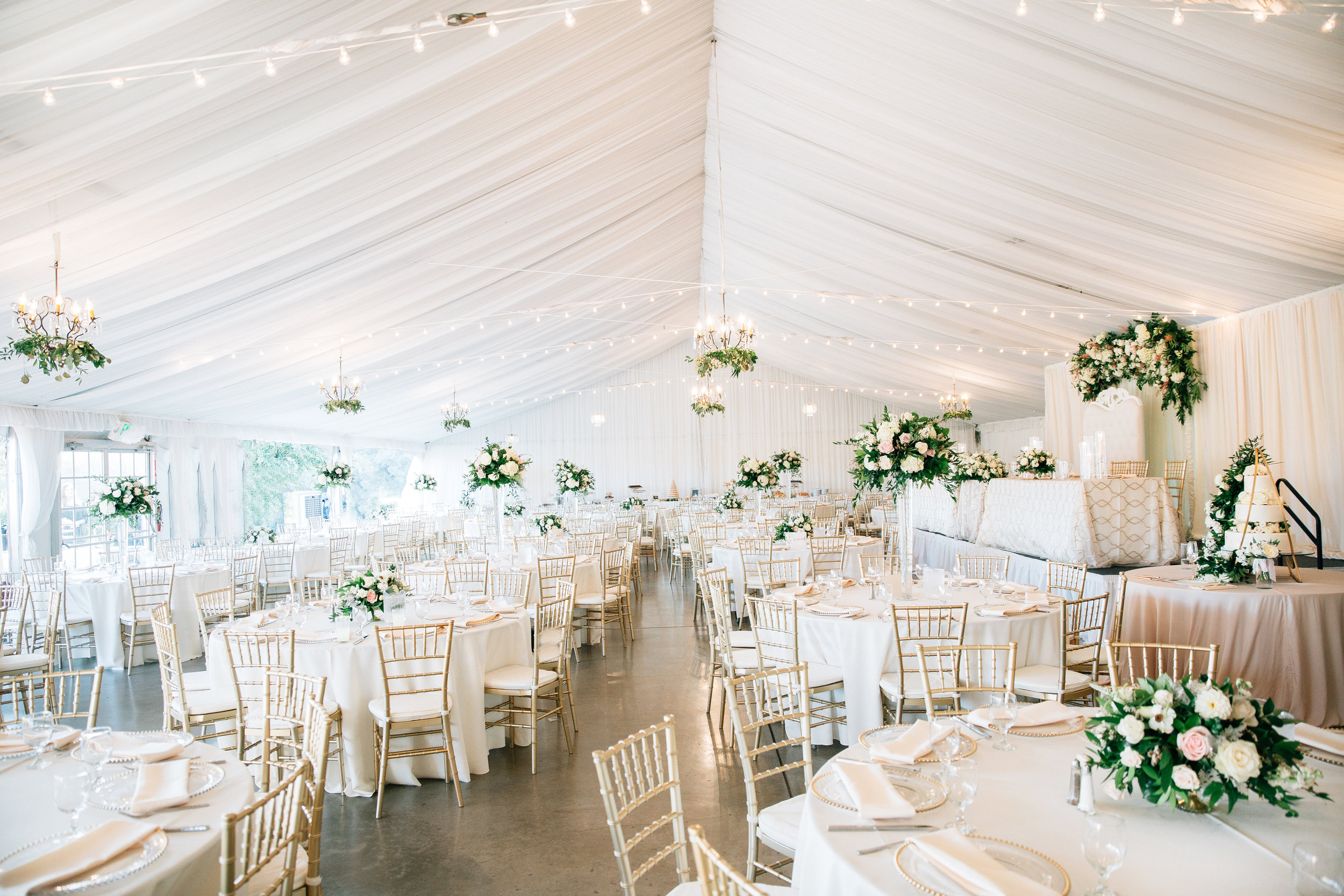 side_view_reception_flowers_white_blush_greenery_tall_short_arrangements_white_tent_violette_fleurs_anna_perevertaylo.jpg