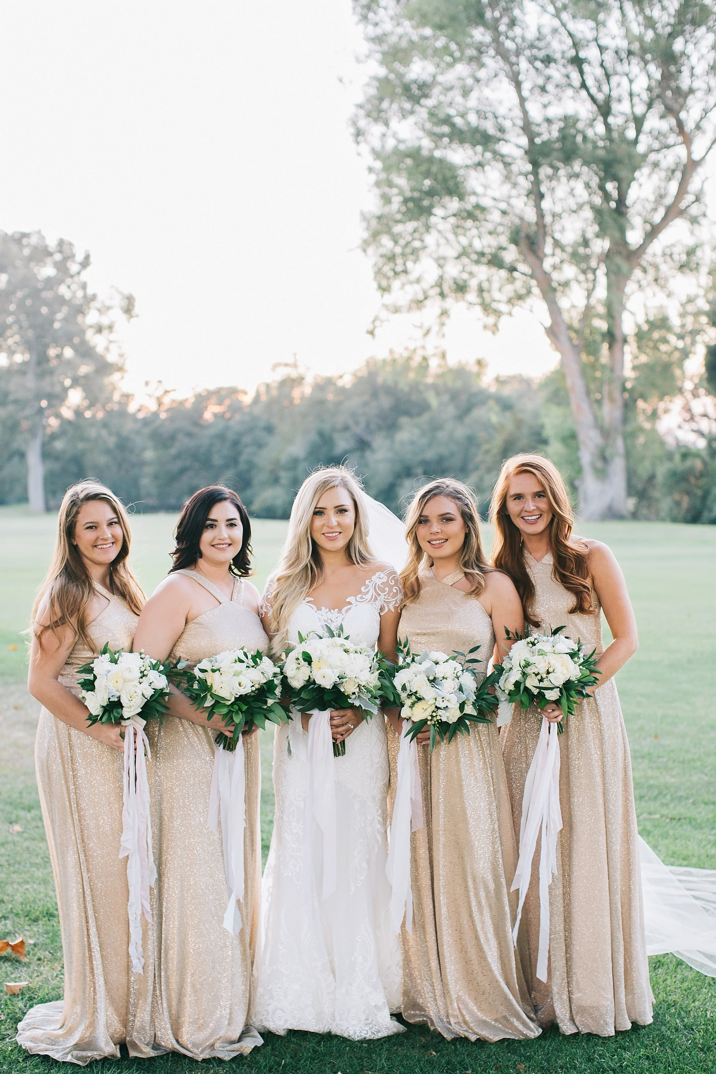 smiling_bride_bouquets_greenery_golf_course_champagne_dresses_violette_fleurs_roseville_anna_perevertaylo.jpg