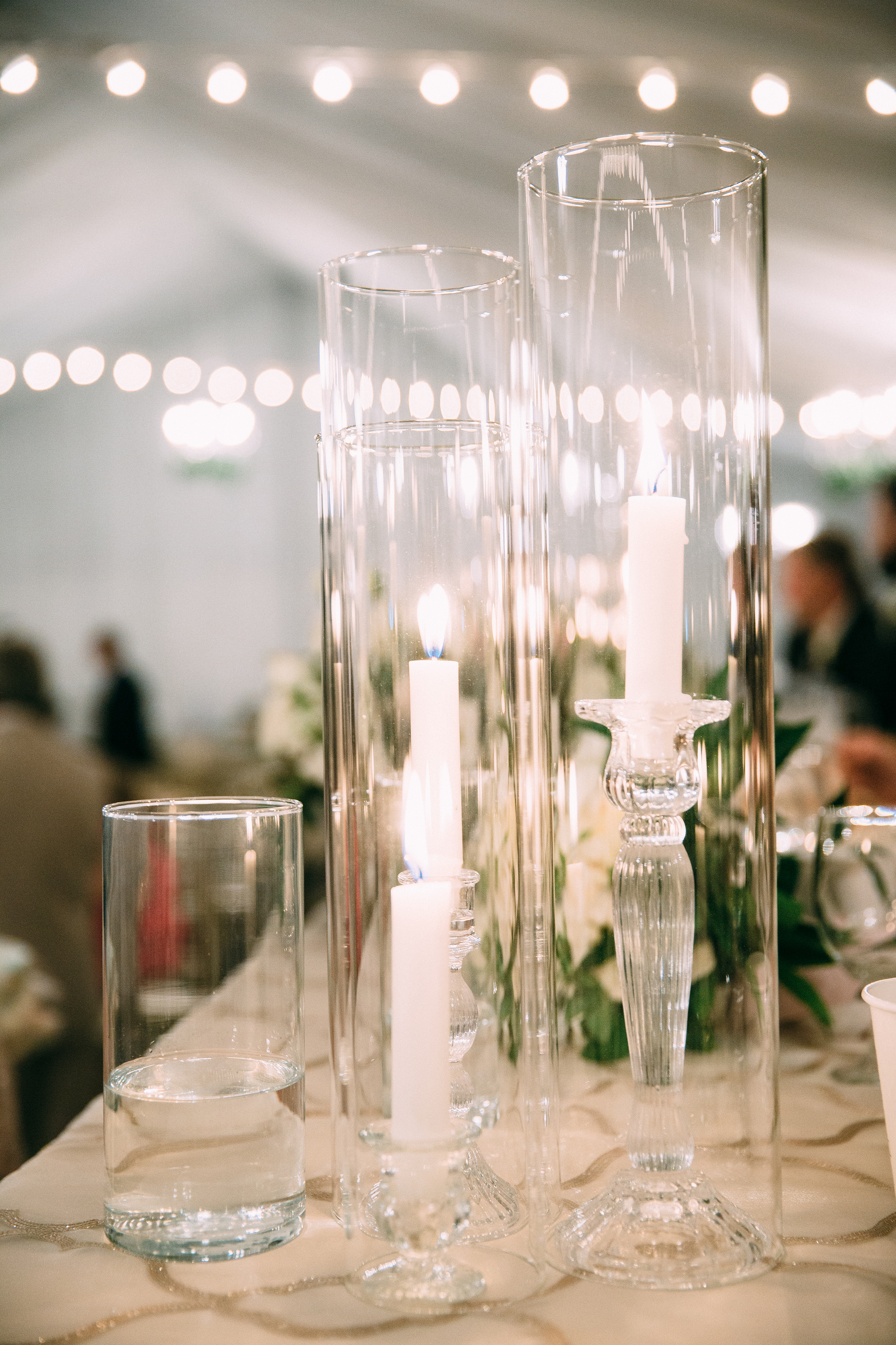 clear_candles_flower_greenery_champagne_tablecloth_reception_violette_fleurs_anna_perevertaylo_haggin_oaks_sacramento.jpg