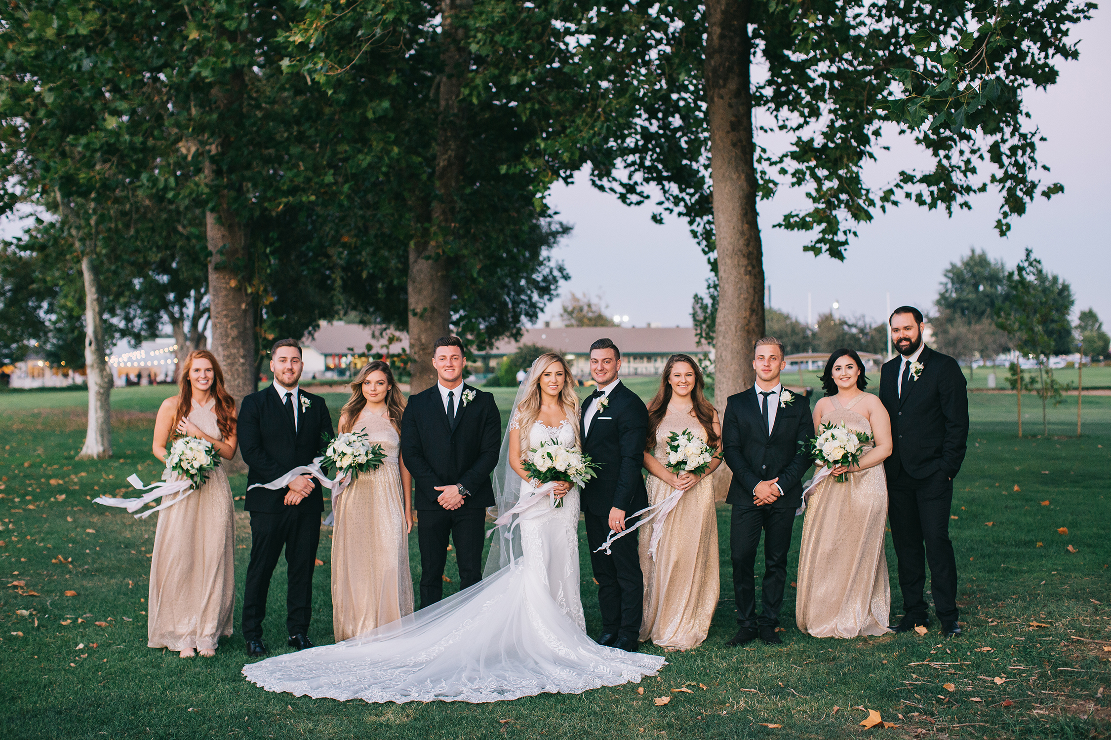 bridal_party_black_suits_champagne_gold_dresses_long_veil_golf_wedding_white_upscale_luxury_ddecor_san_fransisco_napa_violette_fleurs_anna_perevertaylo.jpg