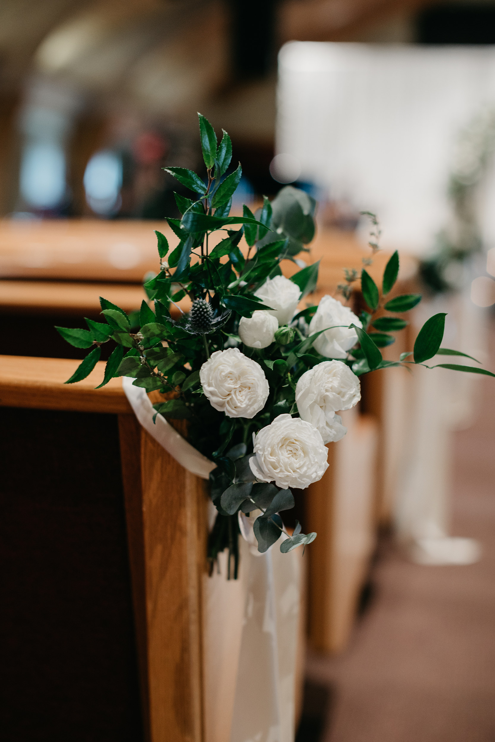 Violette-fleurs-event-design-roseville-Nelli-noel-photography-the-falls-event-center-Flowers-Upscale-Decor-Groom-Bride-pew-details.jpg
