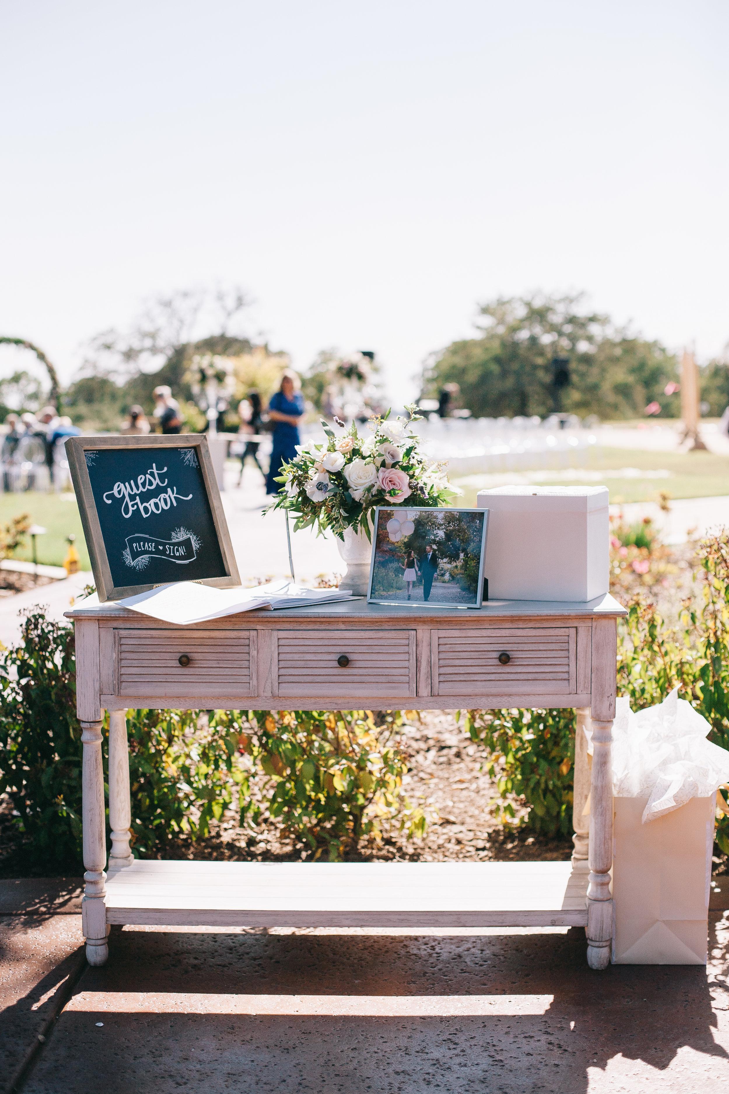 Violette-fleurs-event-design-roseville-anna-perevertaylo-rancho-robles-vinyards-Detail-Bride-groom-Detail-Flowers-sign-in-arrangement.jpg