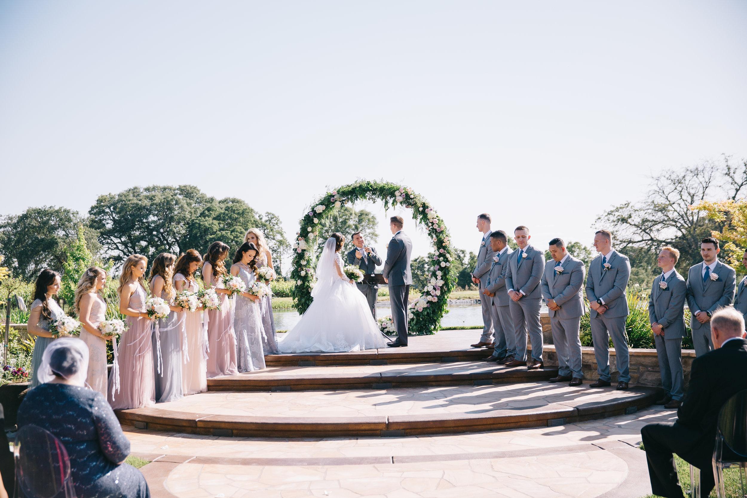 Violette-fleurs-anna-perevertaylo-White-Blush-elegant-flowers-for-wedding-decor-upscale-design-roseville-sacramento-california-rancho-robles-vinyards-lincoln-elegant-luxury-bridesmaids-groomsmen-ceremony-infinity-ring.jpg