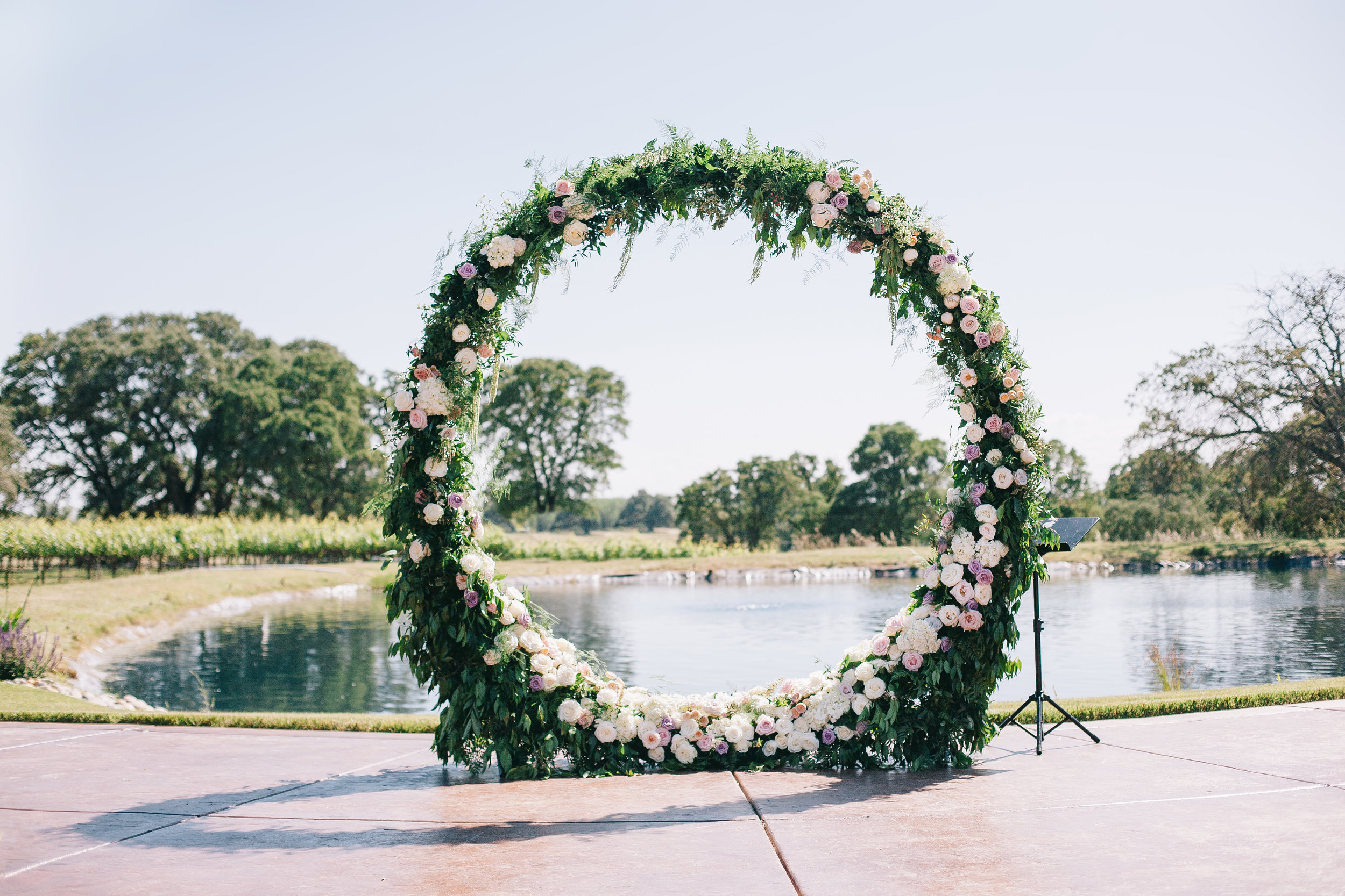 Violette-fleurs-event-design-roseville-anna-perevertaylo-rancho-robles-vinyards-Detail-Beautiful-Decor-Bliss-Florist-ceremony-infinity-ring.jpg