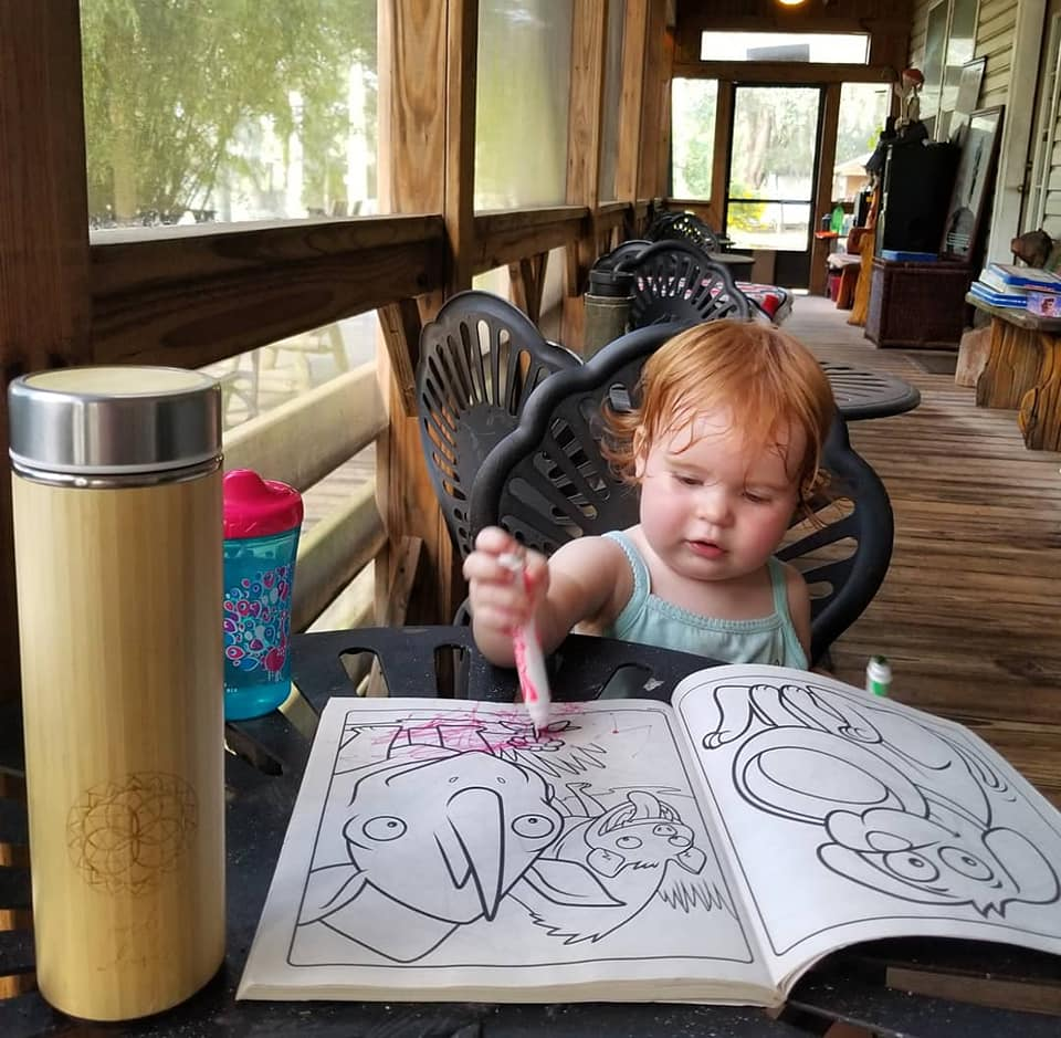 Coloring in the enclosed porch of the main house.