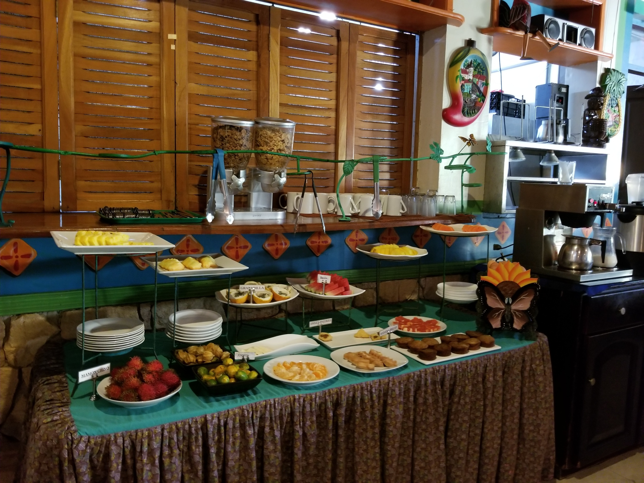 The little buffet you can get fruits and bakery items from while you wait for your breakfast to be cooked fresh.