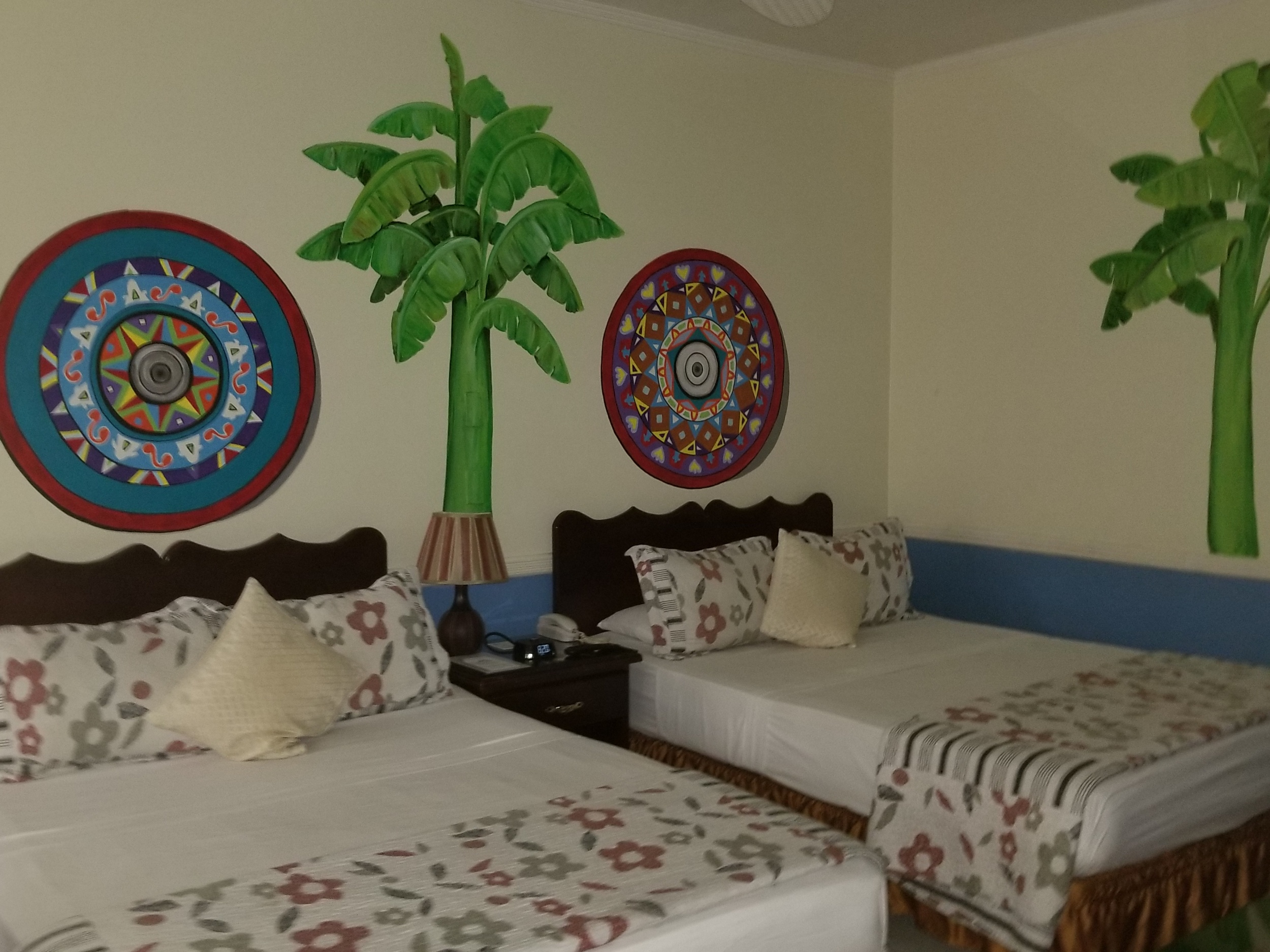 One of the Bedrooms here. They all have beautiful paintings on the wall.