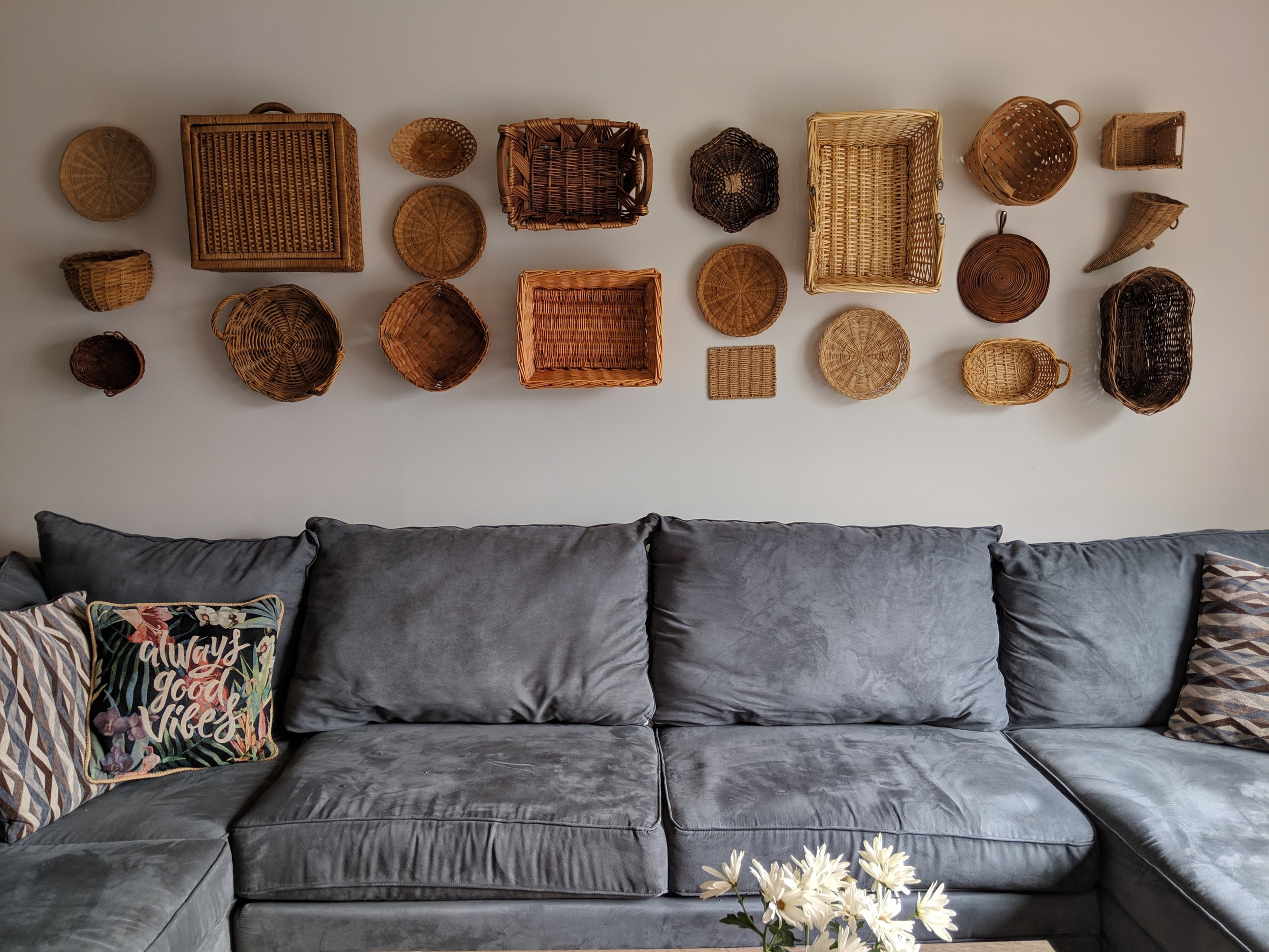 7. Baskets - Every corner of my house has a basket — all sizes, shapes, colors. I just love the tones and textures. I don't remember how much each cost individually, but the basket wall above the couch was less than $20 (in a single trip!).