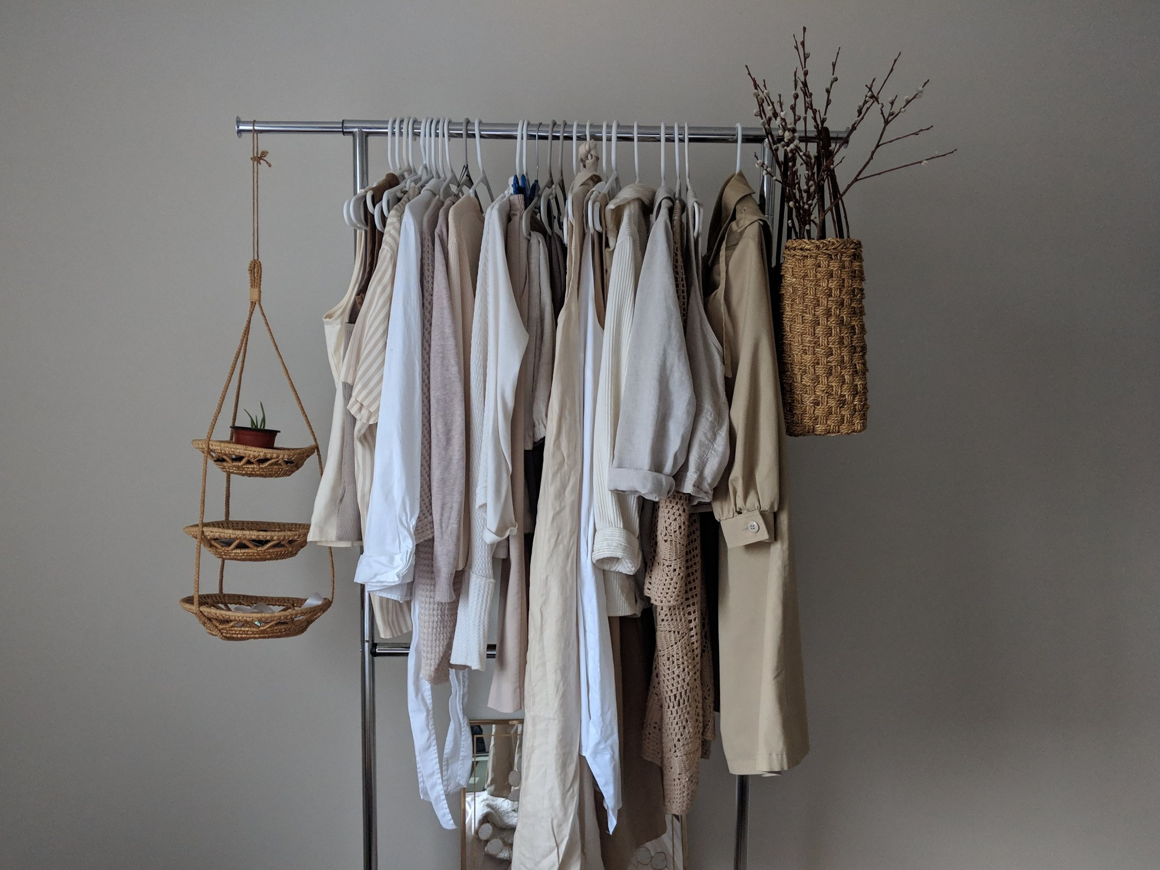 9. Clothing Rack - Craigslist, $15 each: I bought two of these clothing racks from a random cab company on Craigslist and I used them for my clothing swap. Now that it's over, I use it to display all my neutral clothes, which is very much a central part of my bedroom's decor!