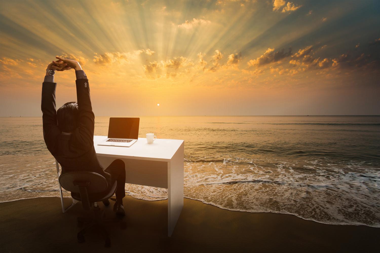 man-at-desk-beach-ocean-sunlight.jpg