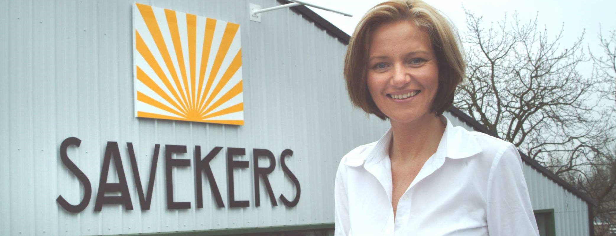 Dani Saveker in front of her family's business in 2003
