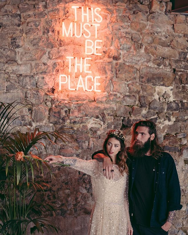 """""""You'll be my queen I'll be your king And I'll be your lover, too""""  Kenzie + Joe's steamy Spanish styled shoot is up on our stories today, turning up the heat on this chilly English autumn afternoon. 😉🔥 #pebbleandafish .  Venue: @thismustbetheplacebcn  Styling: @freshandwood  Dress: @chosenbyoneday  Hair + Makeup: @imanol_fuentes Flowers: @studiofloral Jewellery: @martina_dorta Models: @thebadvillains Workshop: @wildonescommunity"""