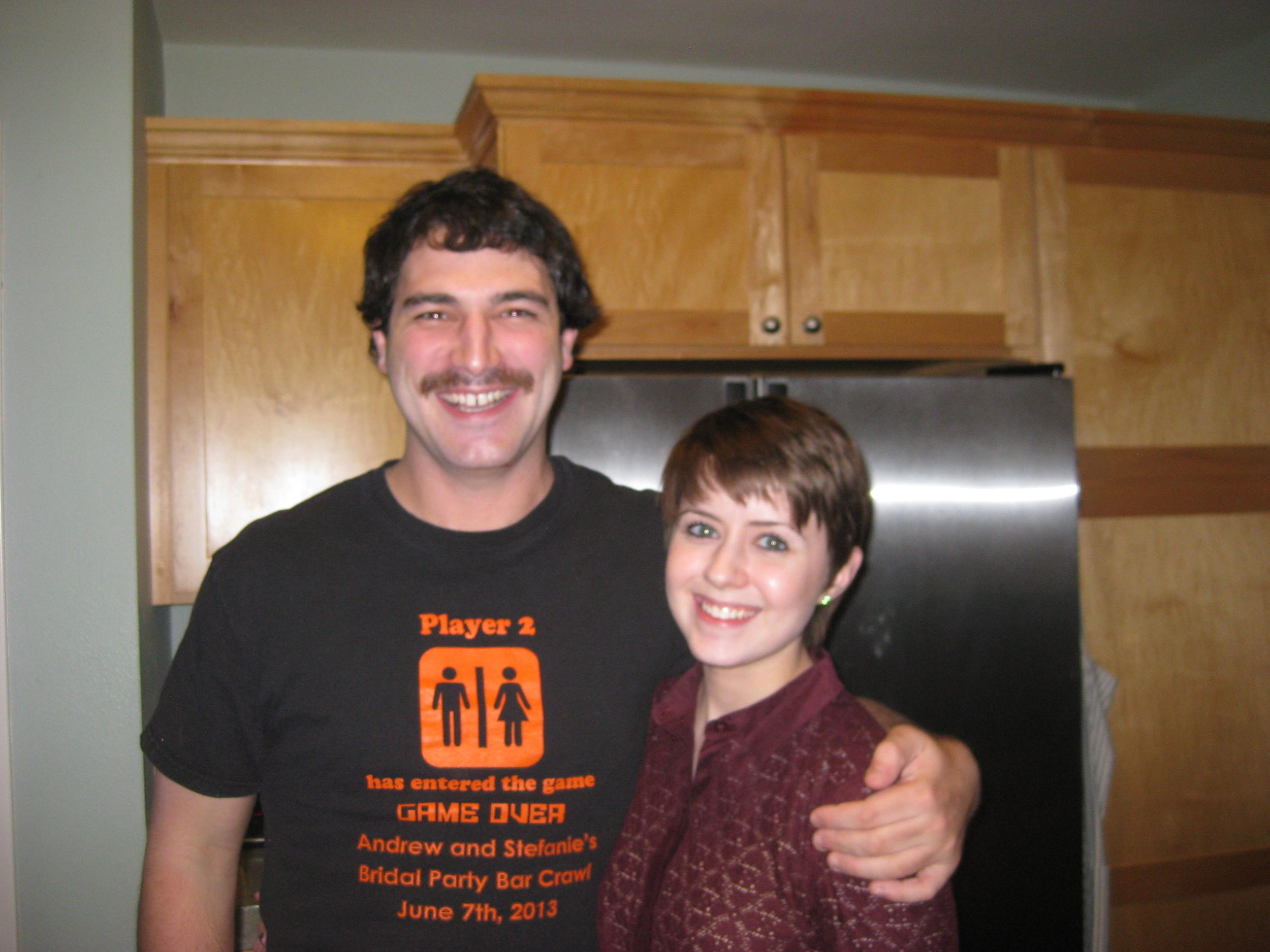Dillon and Megan in Iowa City. Dillon trying out the 'stache for a day!