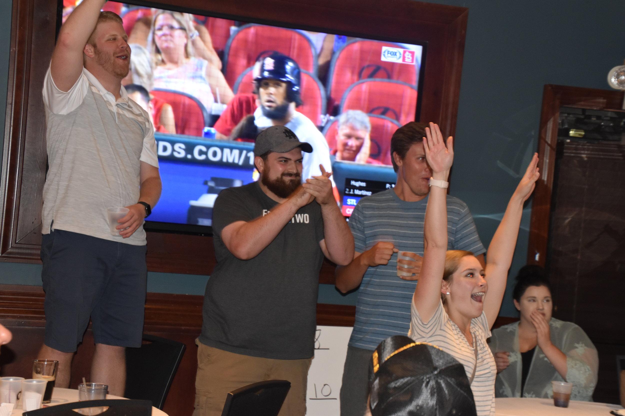 Ryan, Ciarah, and Garrett celebrate the drawing of their A player - Pat Sorrentino!