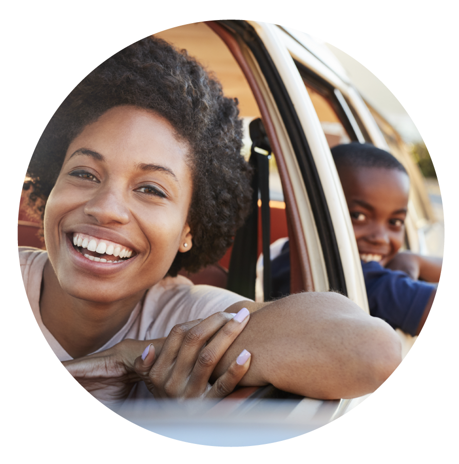 Happy-family-driving-in-car-promo-for-Lifestyle-Health-Plans.png