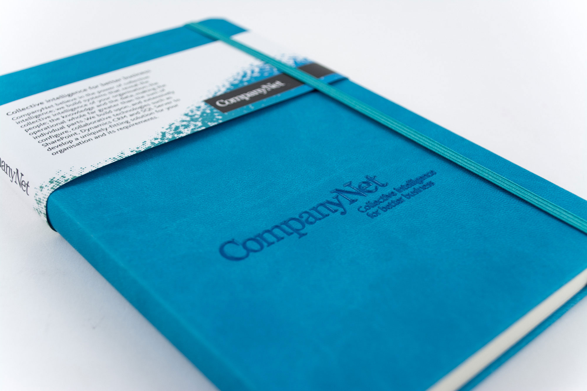 You can easily add more branding to your notebook through clever extras including custom printed belly-bands such as this