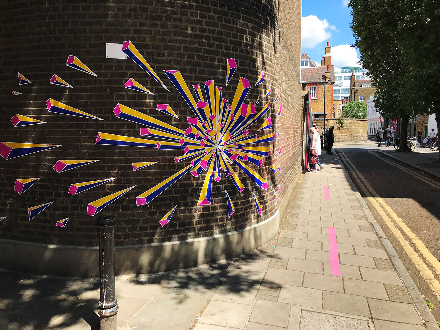 The ubiquitous bright pink markings guide you round Clerkenwell