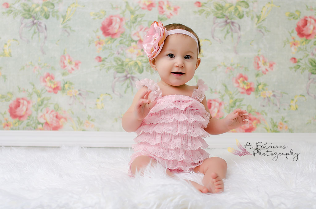 Ruffled Romper and headband provided by  Jazzy Vintage Couture