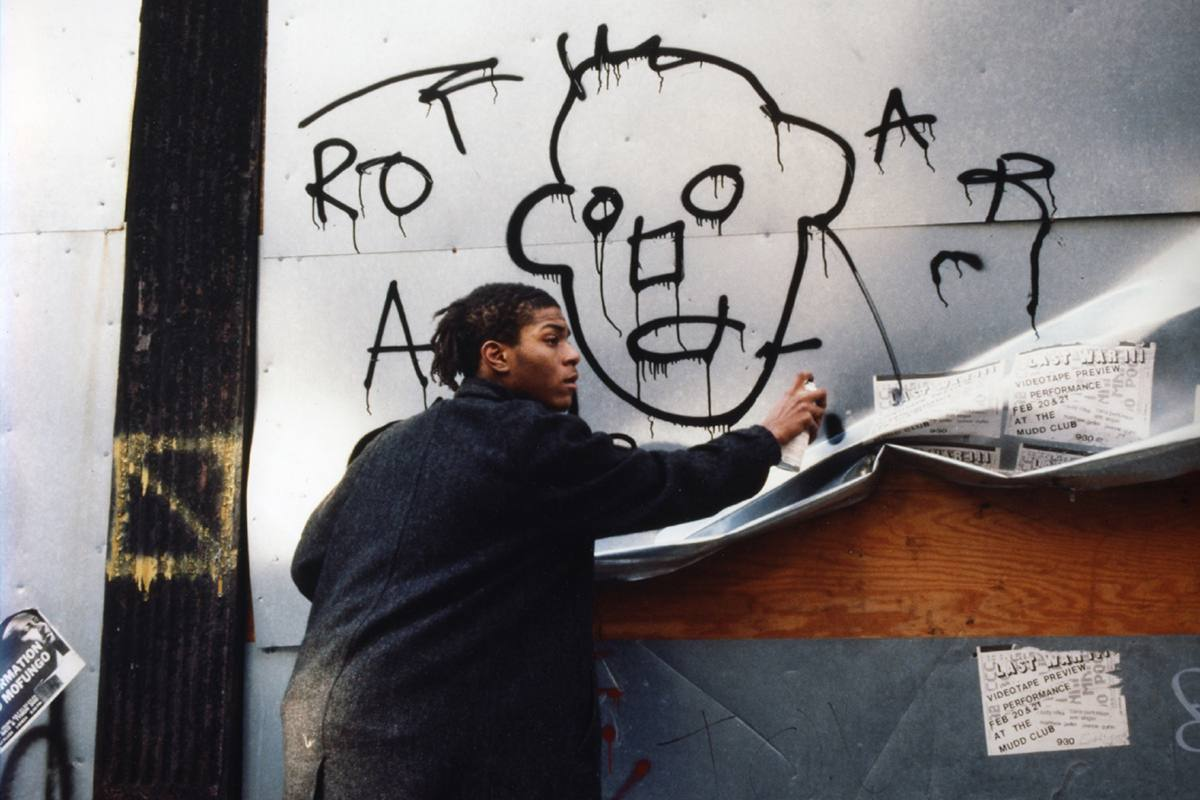 Jean-Michel Basquiat painting a mural in 1988's New York City.