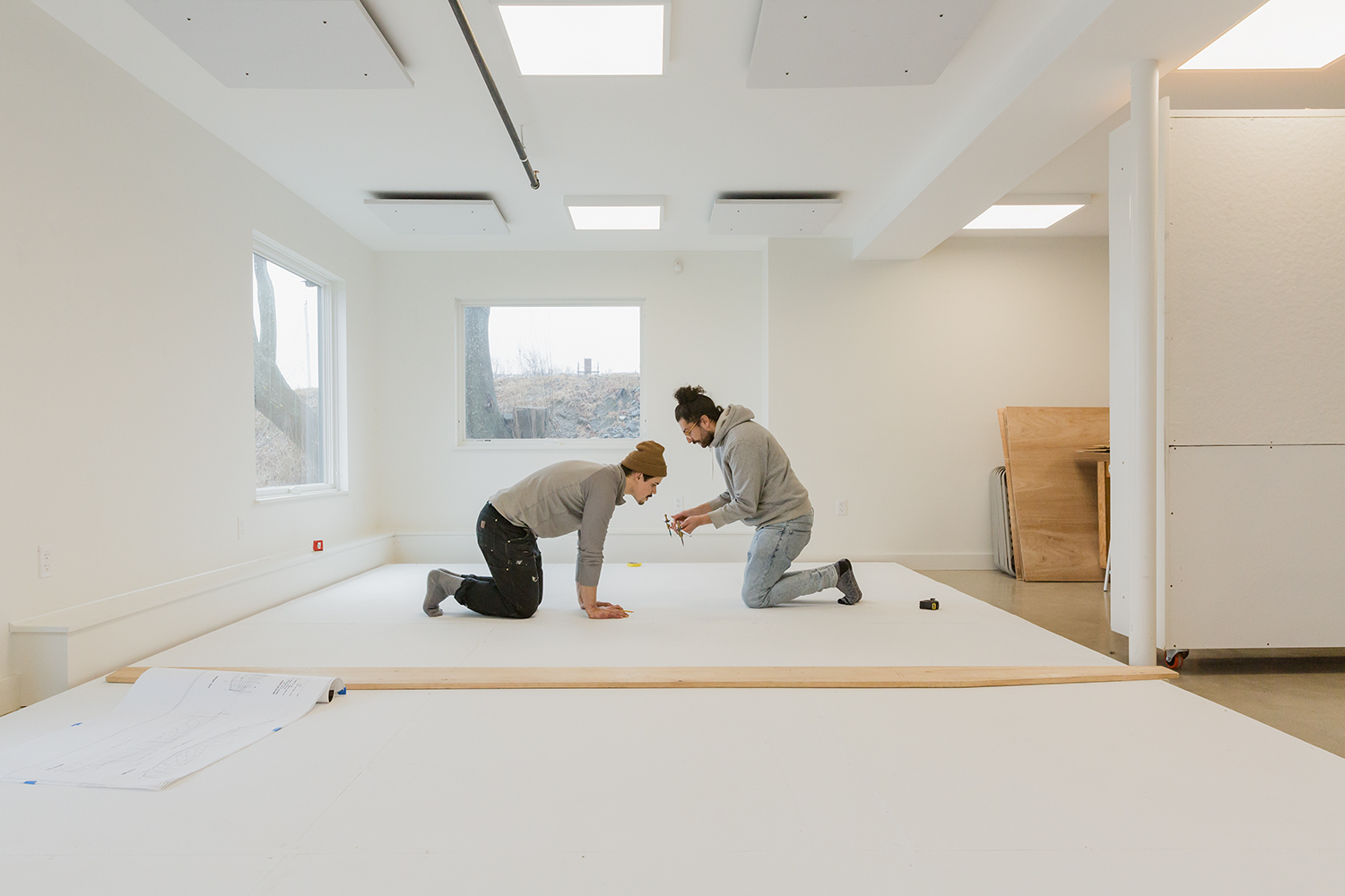 Measuring with João during the early stages of lofting; here, the drawing of grid lines. Photo: Erin Tokarz