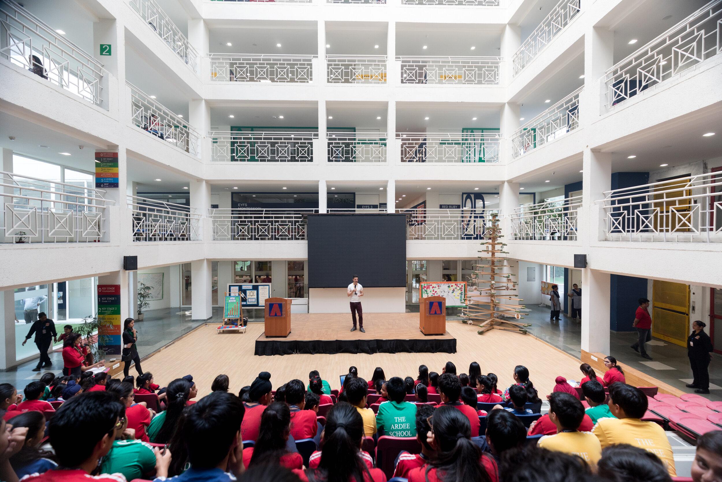 Ballet Rising director Casey Herd speaking with schoolchildren in New Delhi, India about life as a ballet dancer.