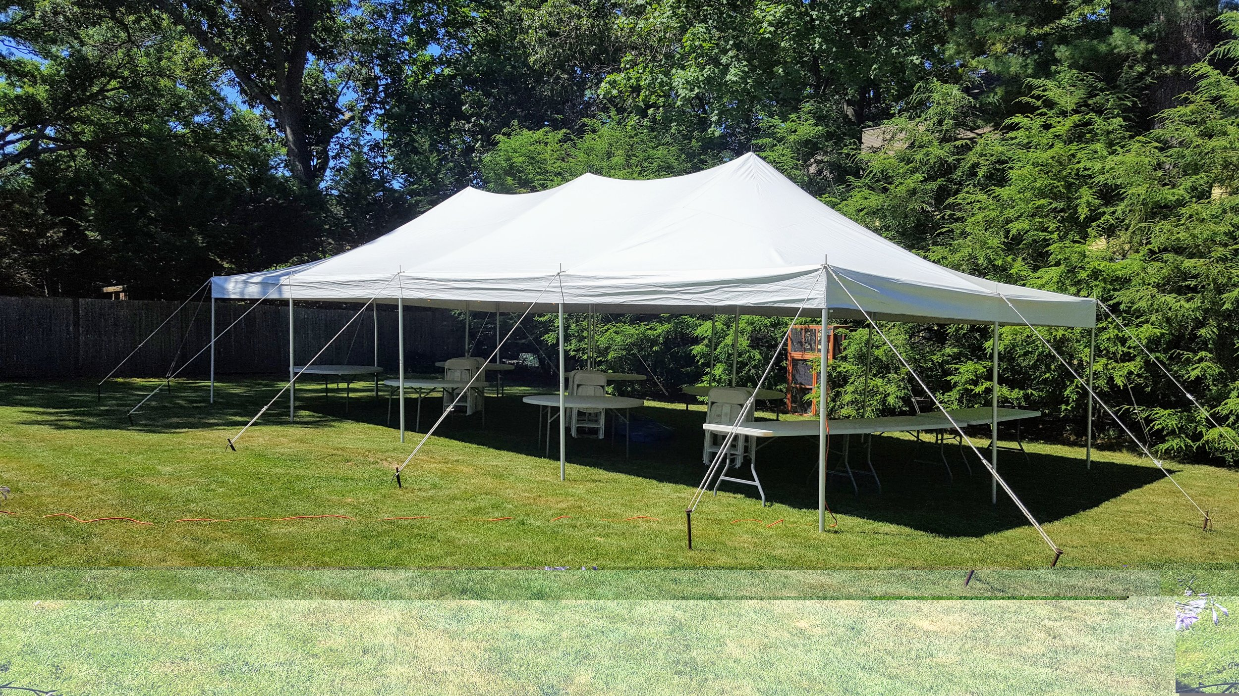 This is a canopy tent - Notice the ropes and stakes anchoring the tent in place.