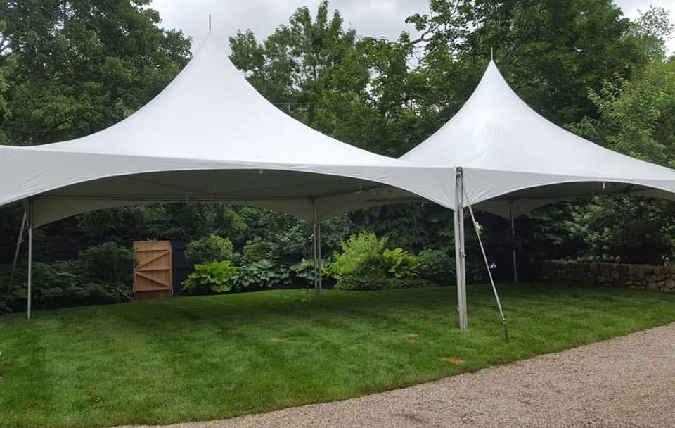 This is a frame tent - Notice the tent is open underneath, with no center poles. The tent requires less staking.