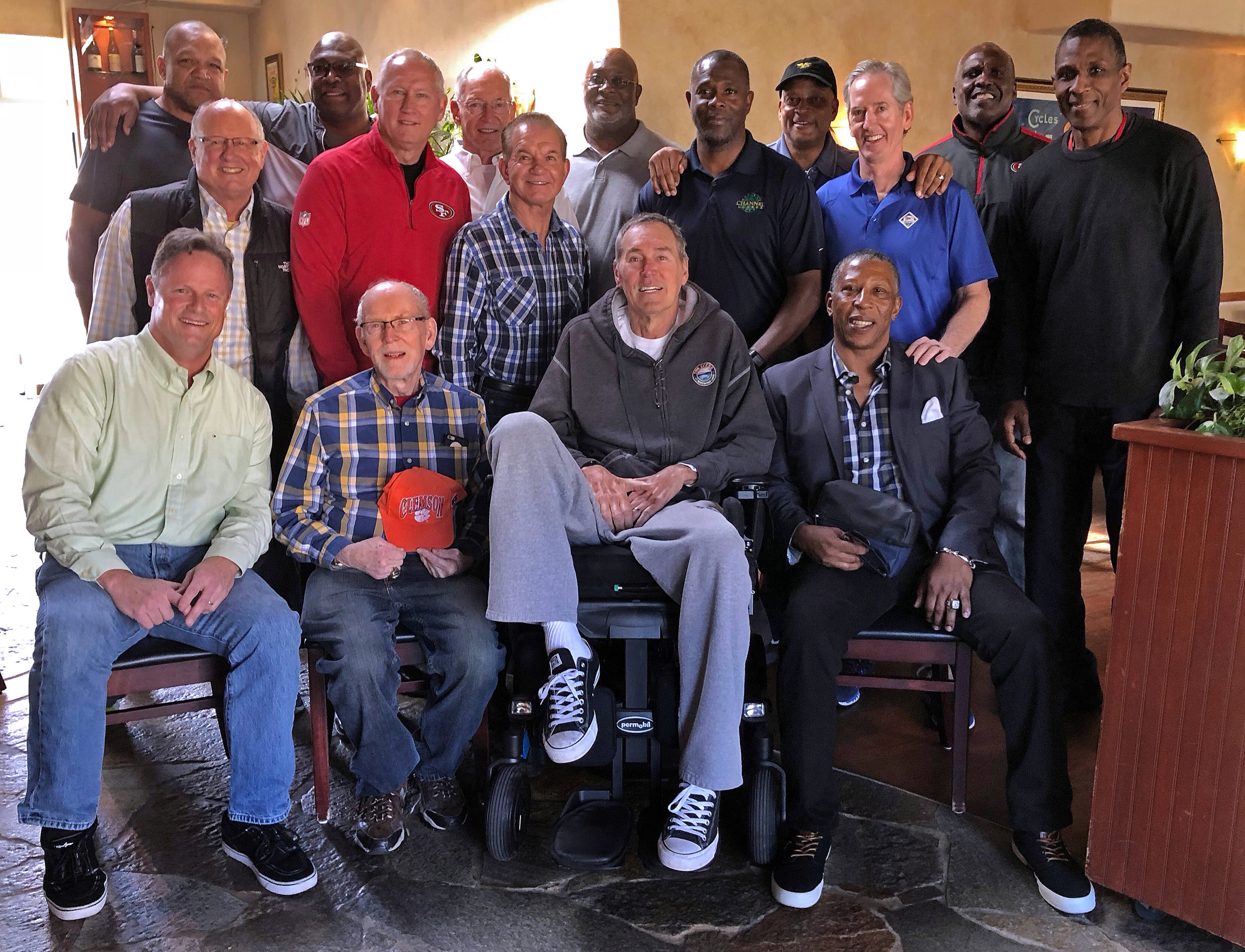 Dwight Clark gathers with teammates, coaches, and friends before lunch in Capitola, California, on March 6, 2018.
