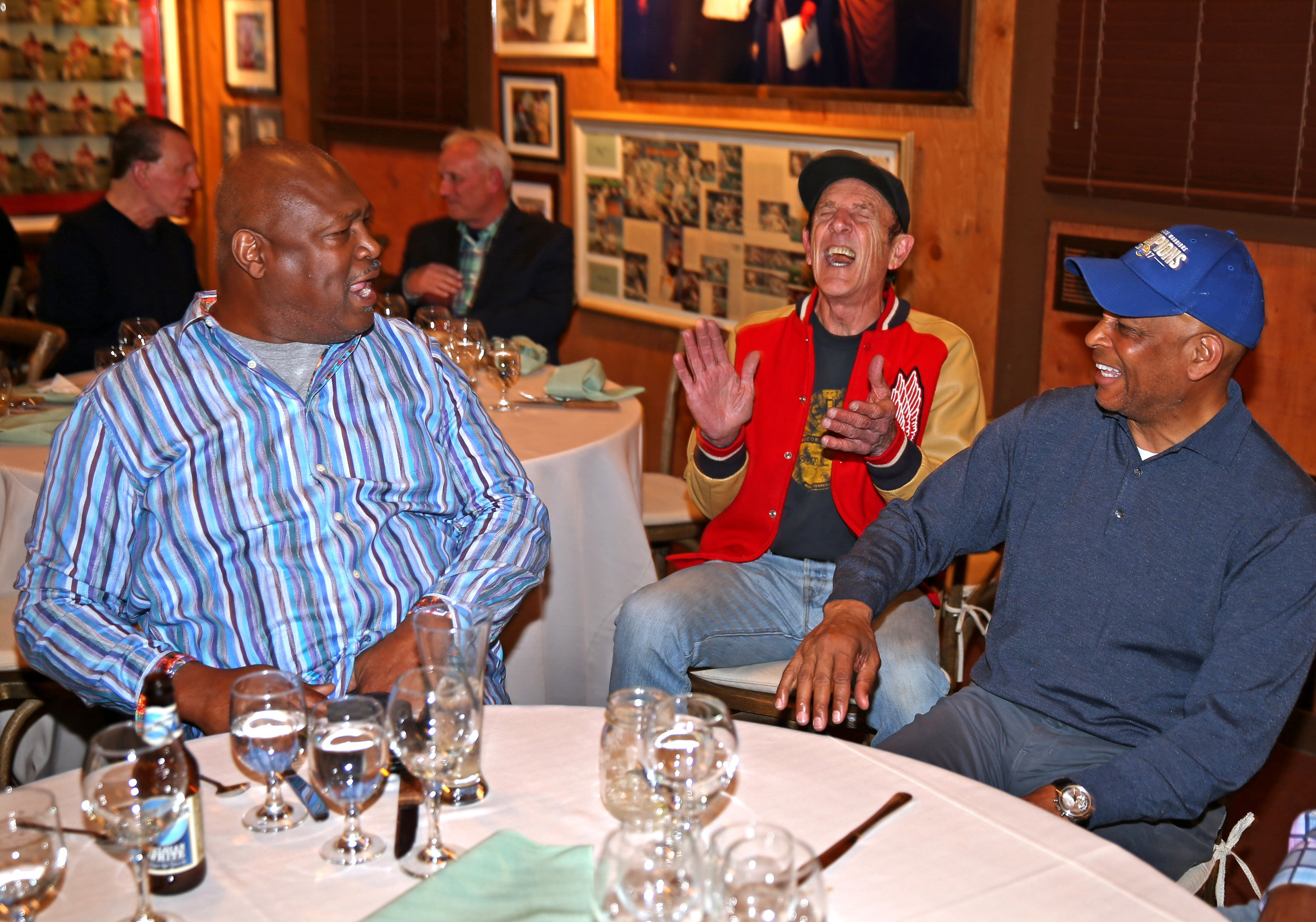 Charles Haley, Michael Zagaris, and Ronnie Lott laugh at the reunion organized by Eddie DeBartolo in Kalispell, Montana on April 23, 2018.