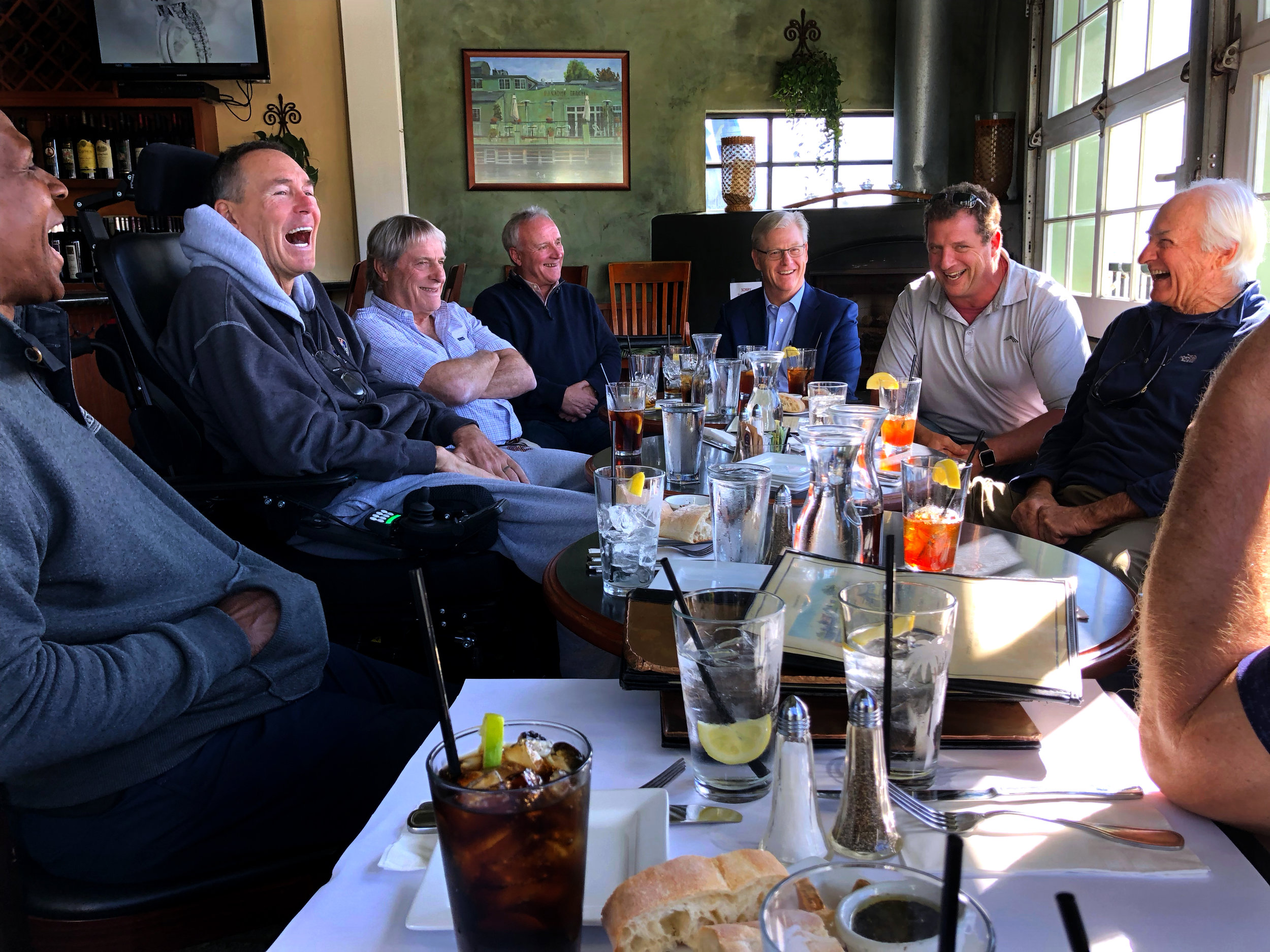 Dwight Clark laughs with teammates, coaches, and friends at lunch in Capitola, California, on January 30, 2018.