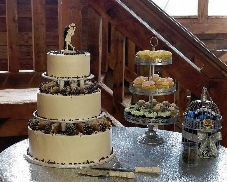 WEDDING CAKE - Custom ordered layered sponge cake with classic New York cream filling topped with fresh cannoli and mini chocolate chips. Contact us for pricing.