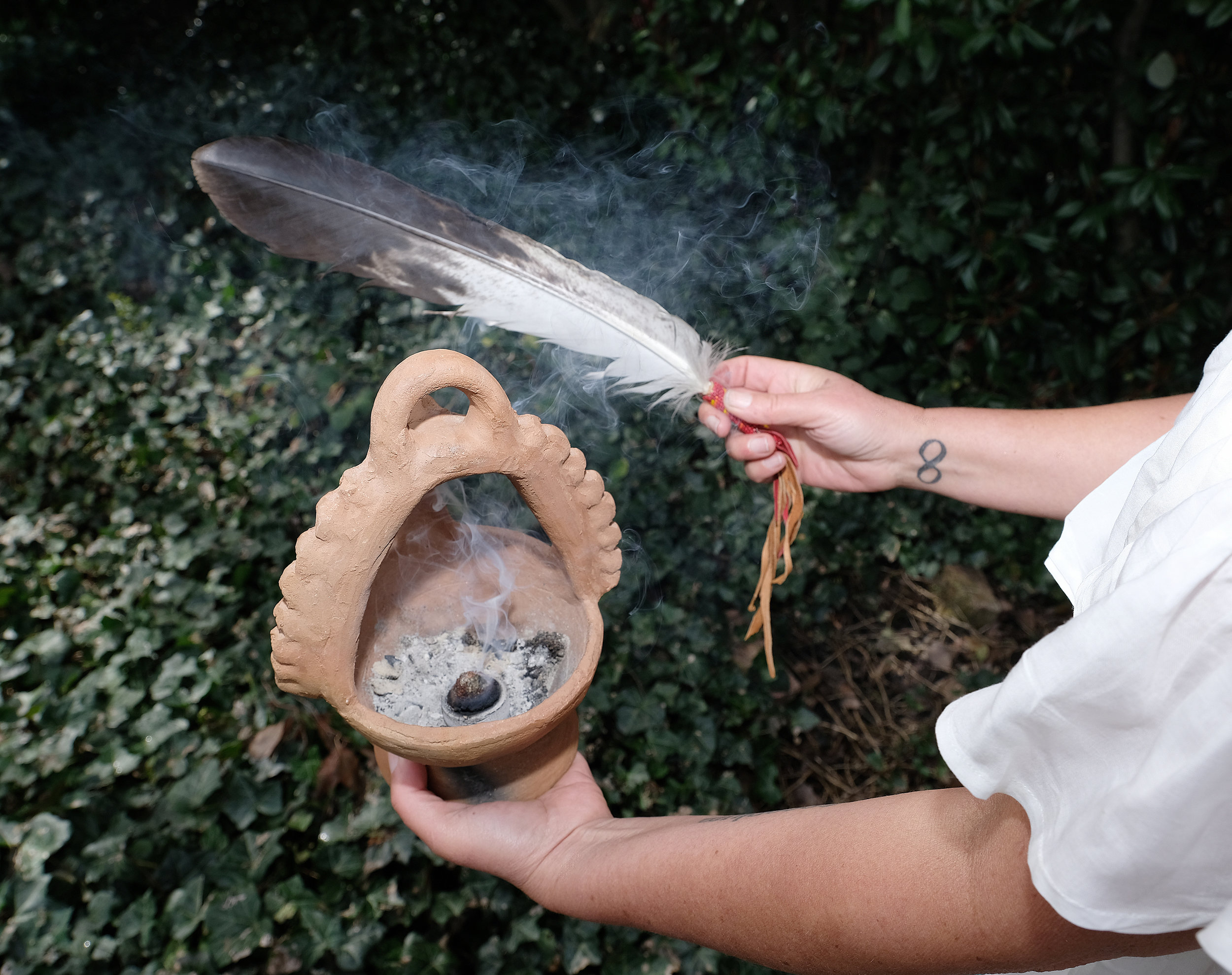 Pleiadians shamanic smudge with smoke and bird feather