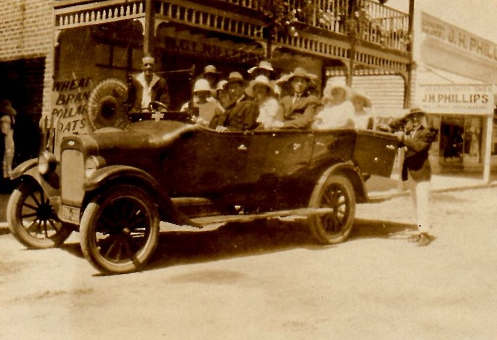 Percy Bignell Chevrolet Charabanc BN38 outside Killerby's Prince St shop, c1924