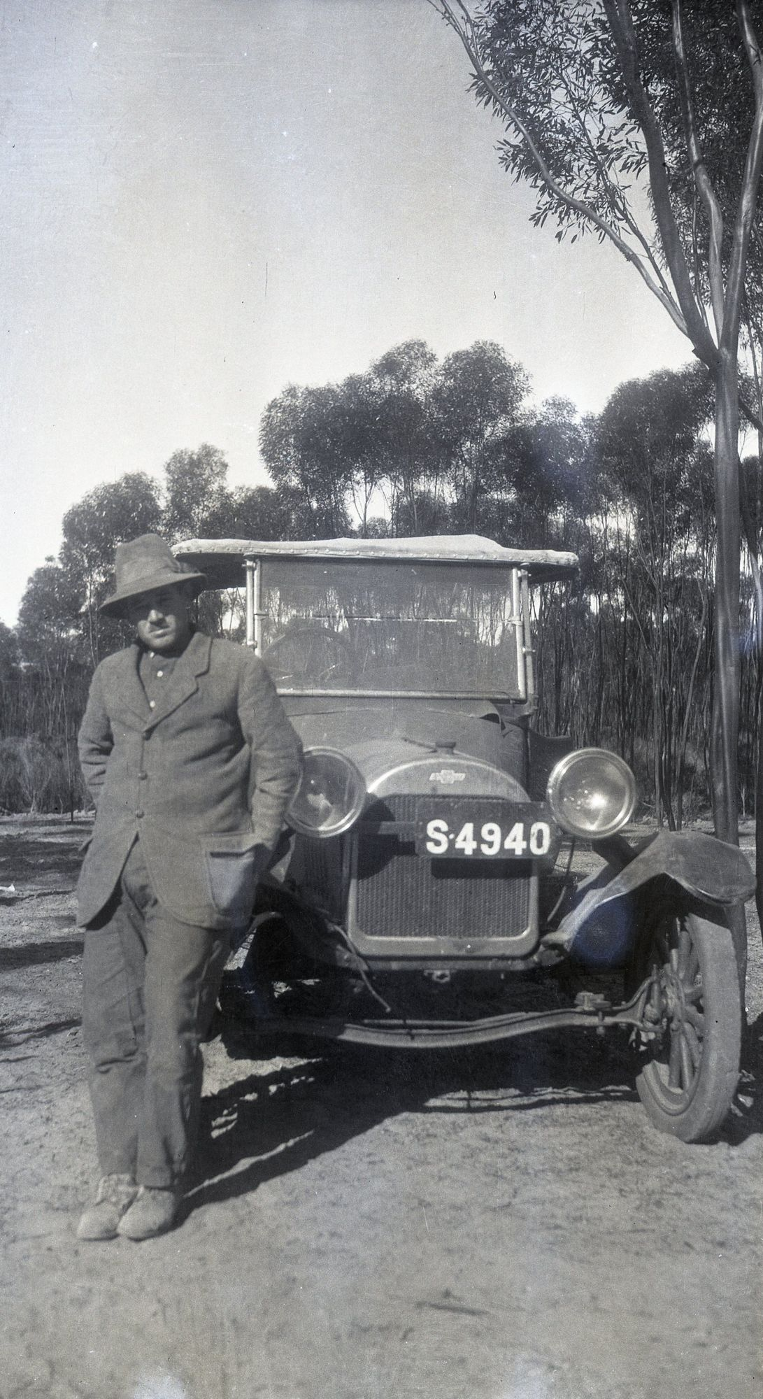 Unknown man & 1920s Chev 490