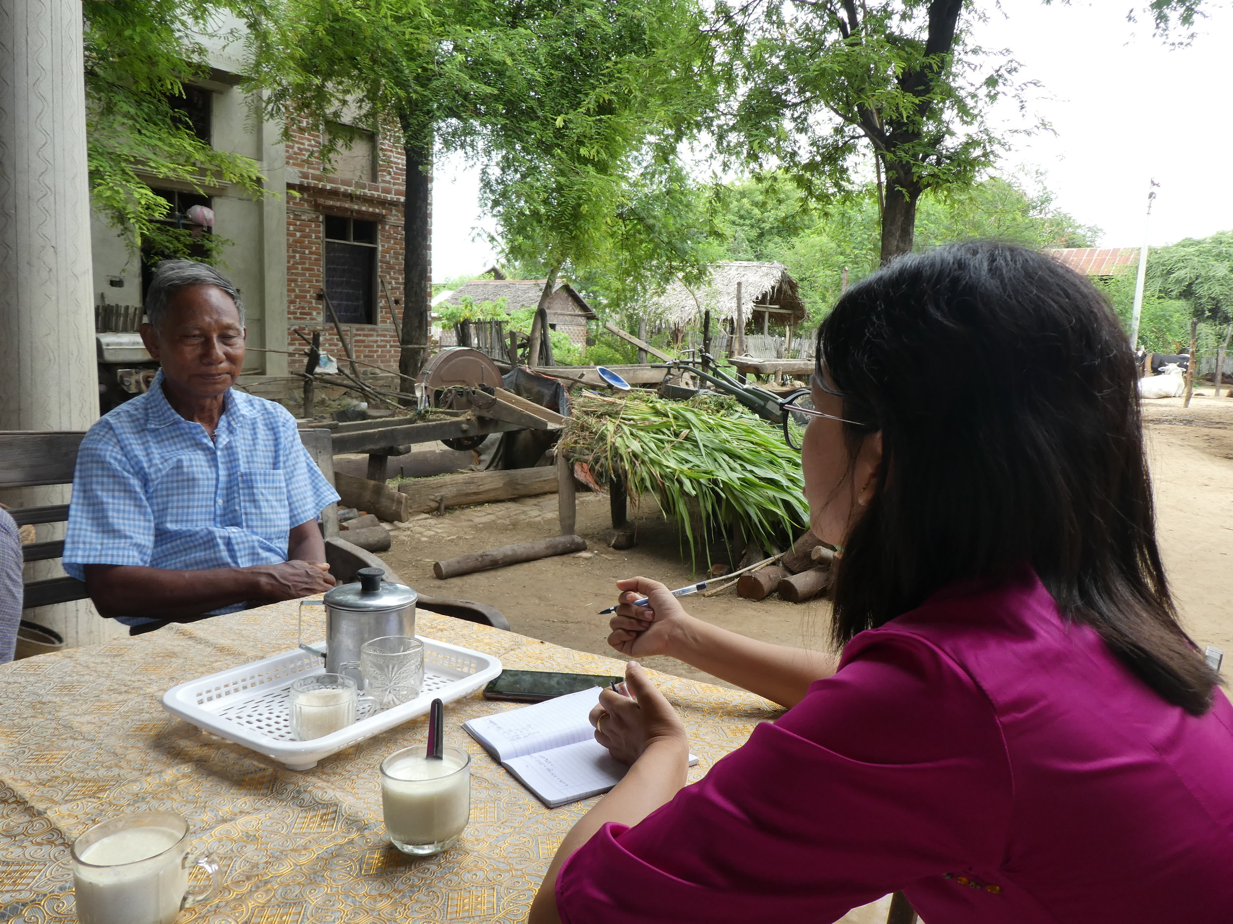 MDEP counterpart Dr Khaing Thida Aung drinking fresh milk while discussing heifer rearing with U Toe Maung