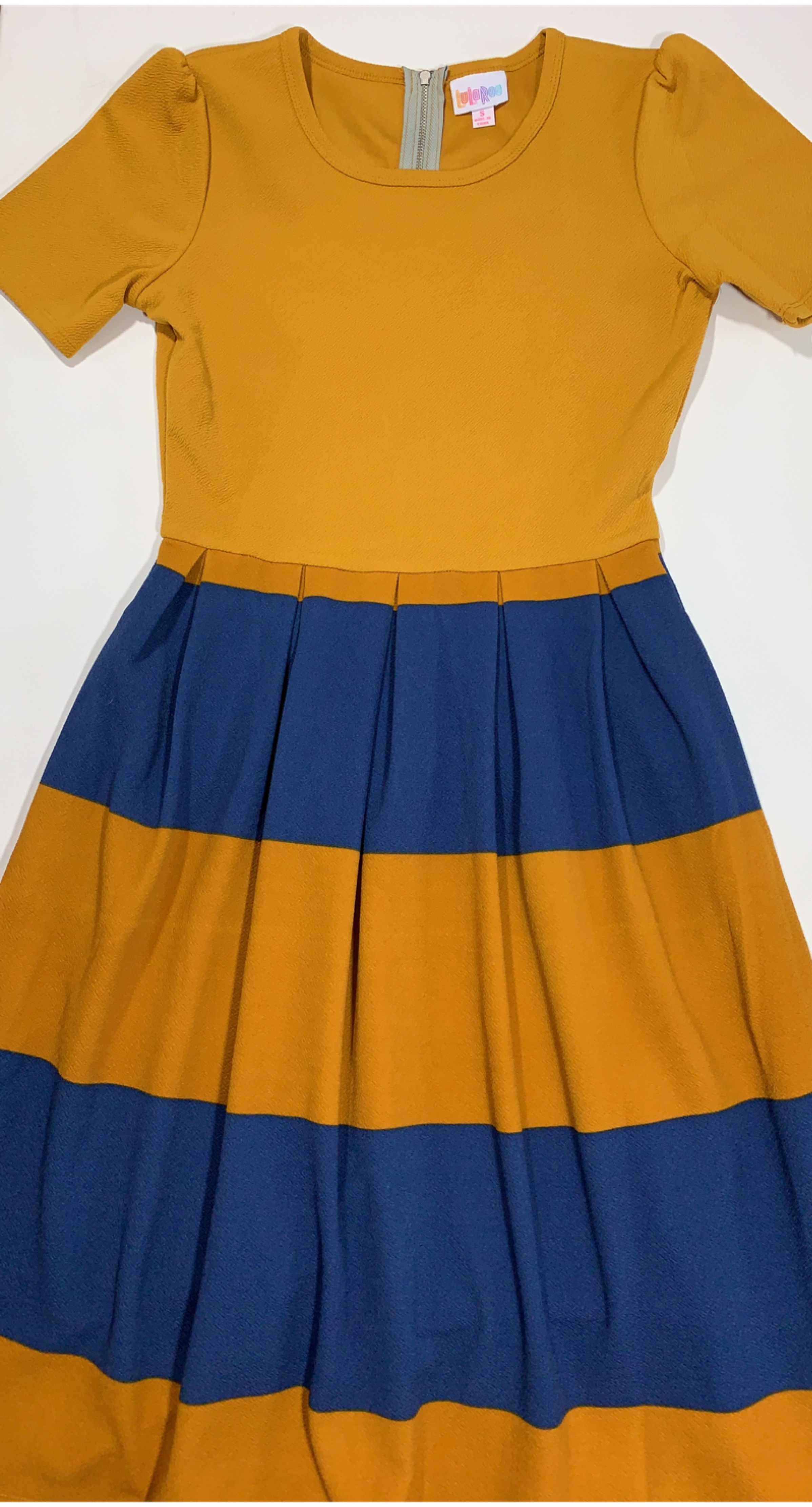 - 1) Determine your starting point or inspiration piece.This box pleated waist dress serves as a great starting point with a larger print striped skirt.2) Choose a color or two that you like in the inspiration piece to pair with a coordinating pattern.