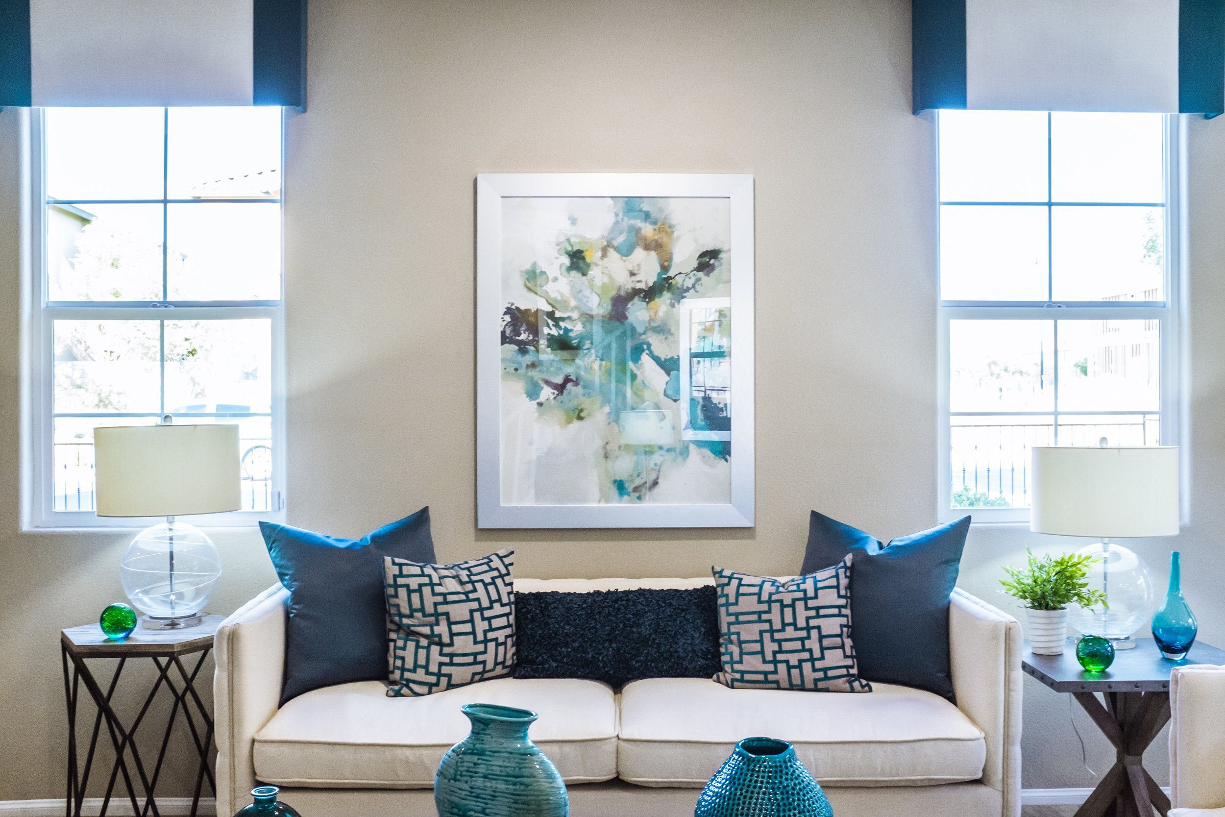 The accessories in this room are a great example of using a monochromatic color scheme. The varied shades of blue paired with the various textures offer a balanced space that is visually interesting.